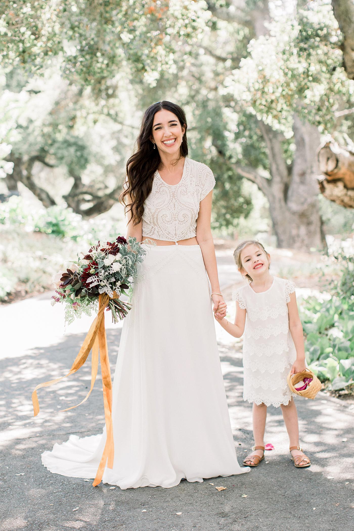 scalloped wedding decor bride and flower girl dress