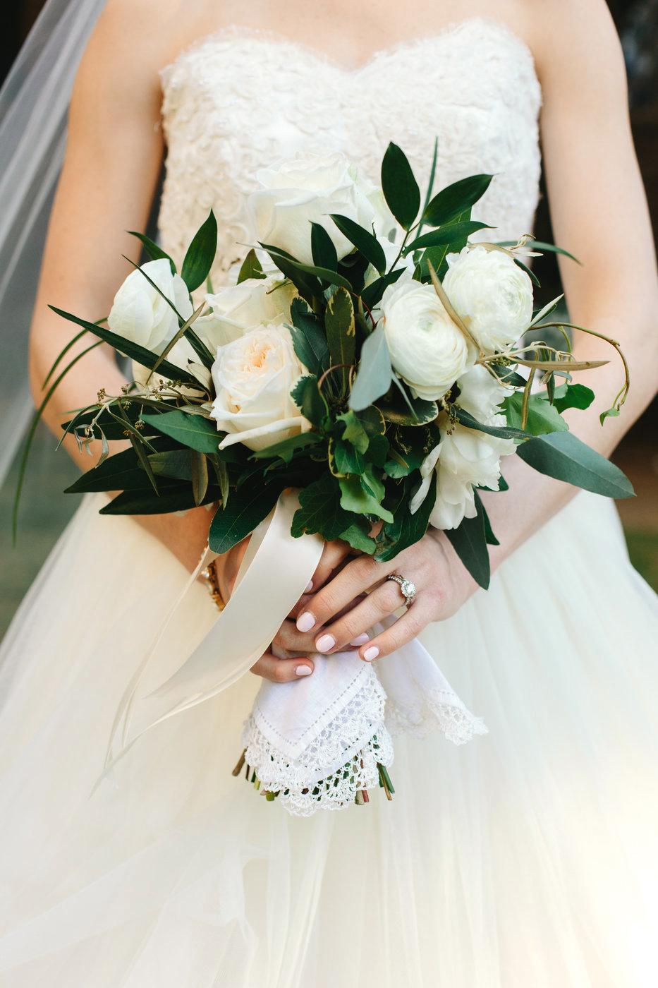 scalloped wedding decor bride with handkerchief around bouquet stems