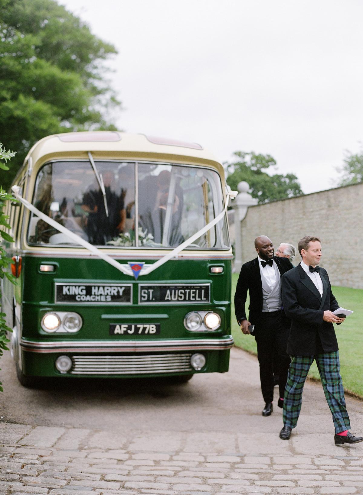 peony matthew england wedding groomsmen exiting shuttle