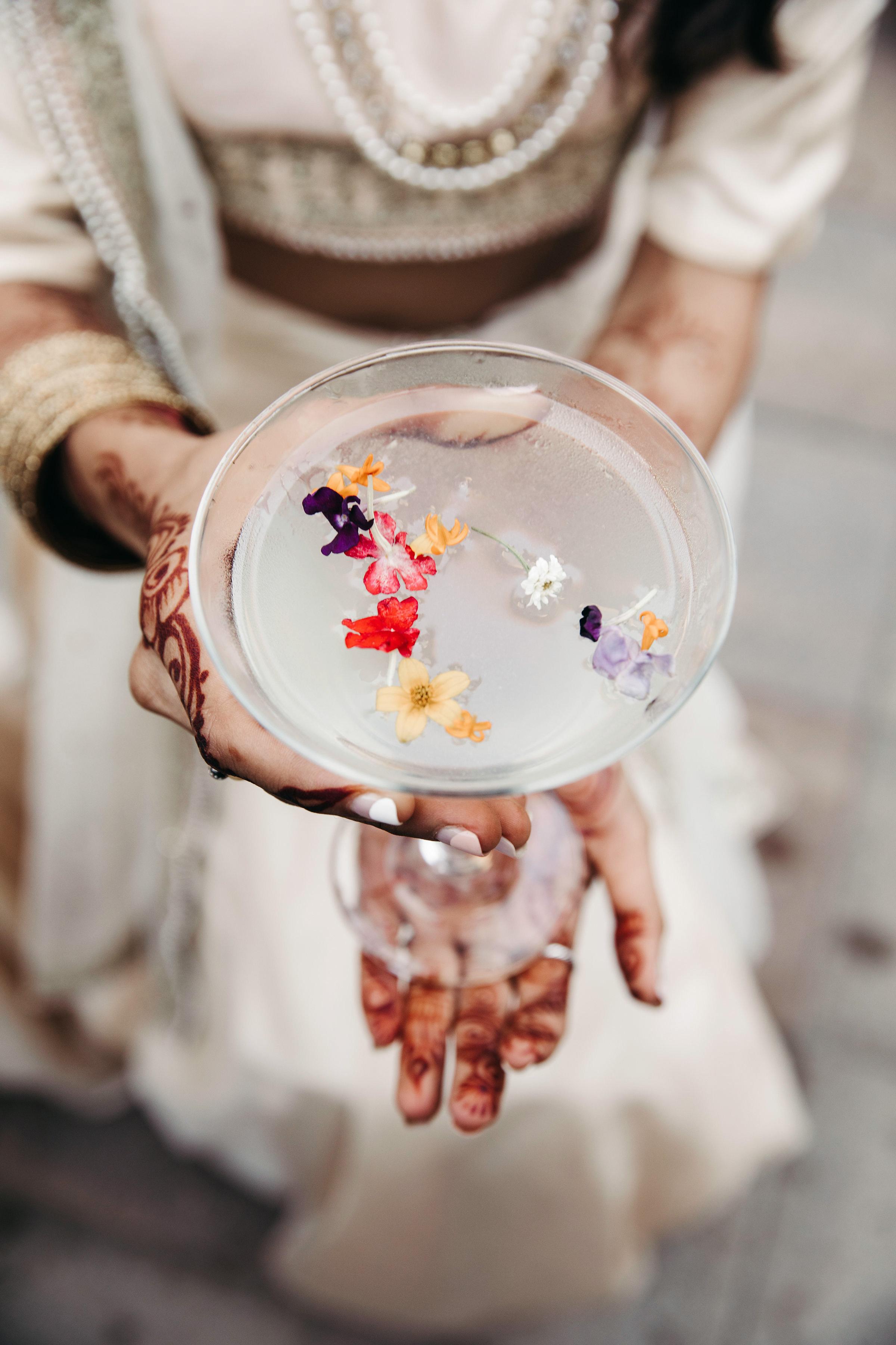 wedding beverage with gin elderflower edible flower garnish