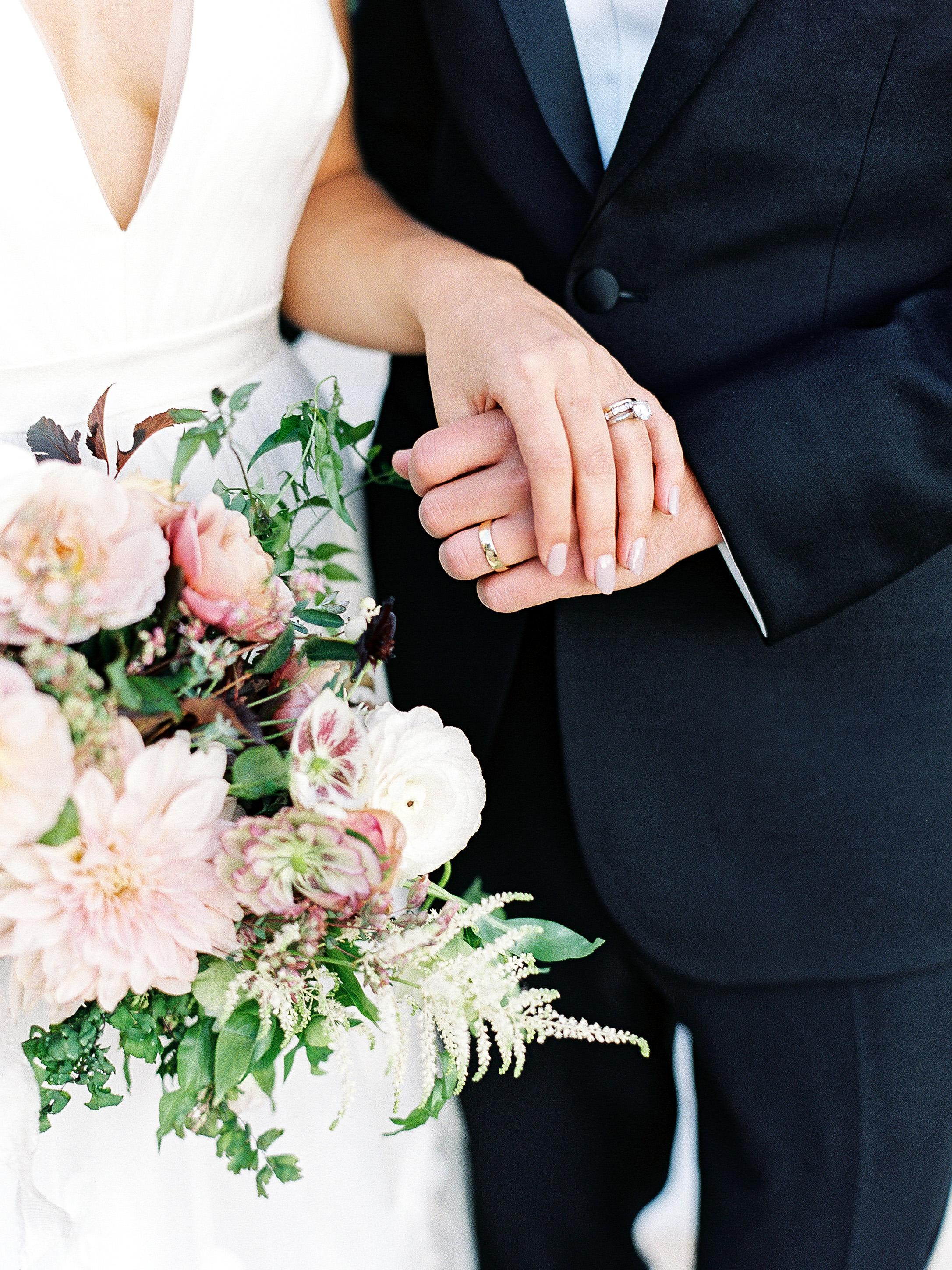 julianne aaron wedding couple hands rings