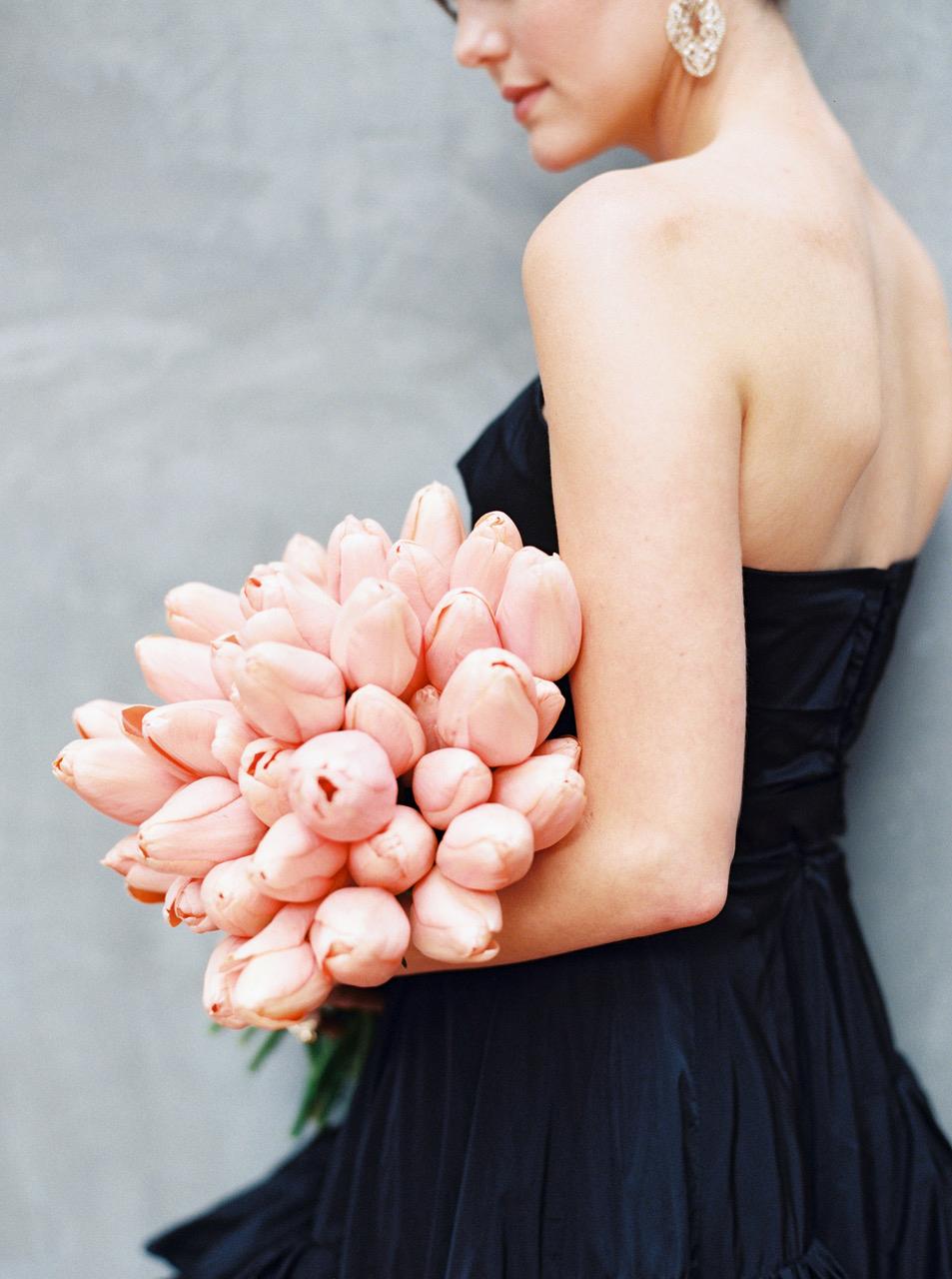 single flower wedding bouquet pink tulips held by bride in black dress