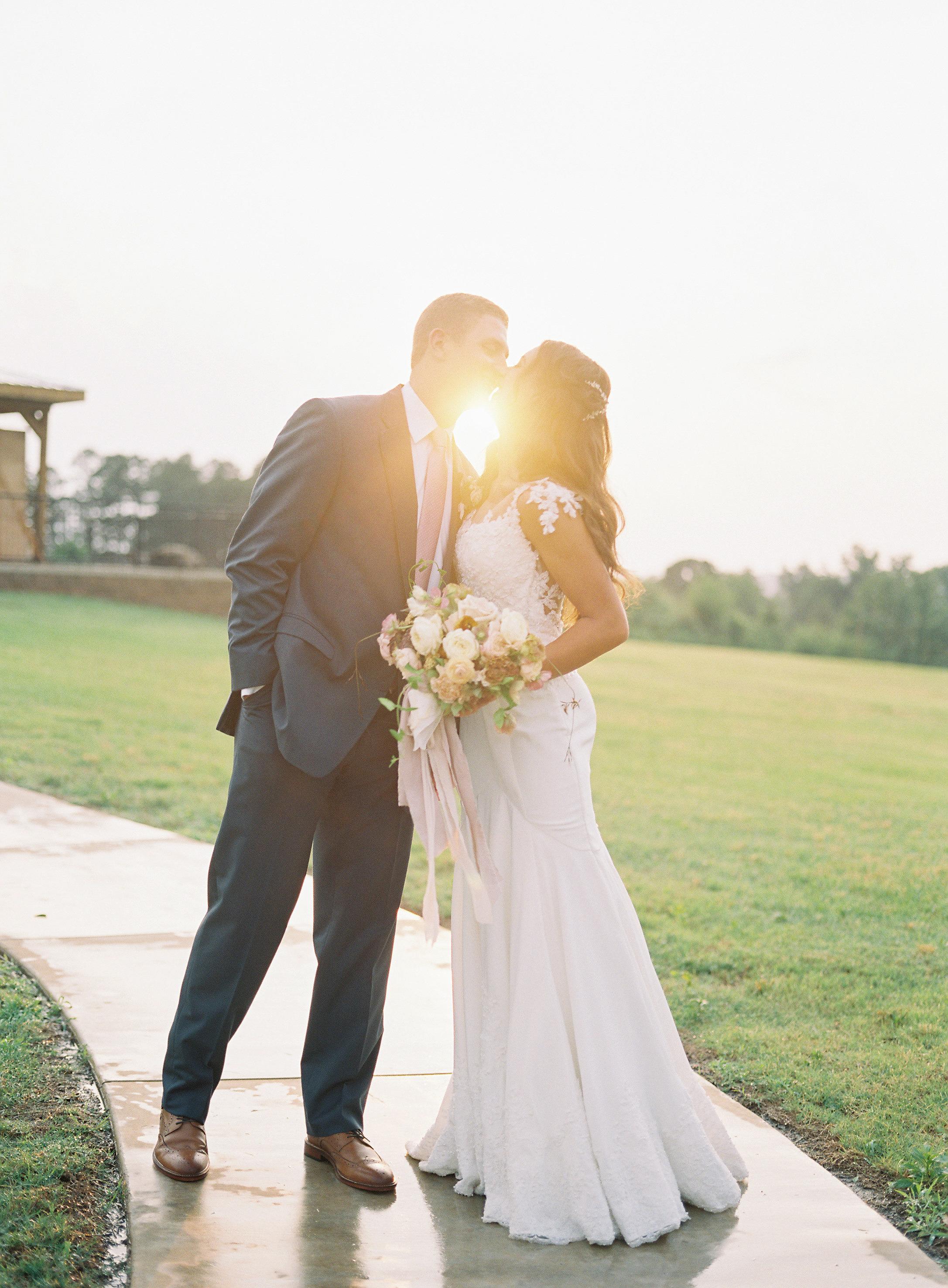 wedding couple kiss sun silhouette sidewalk