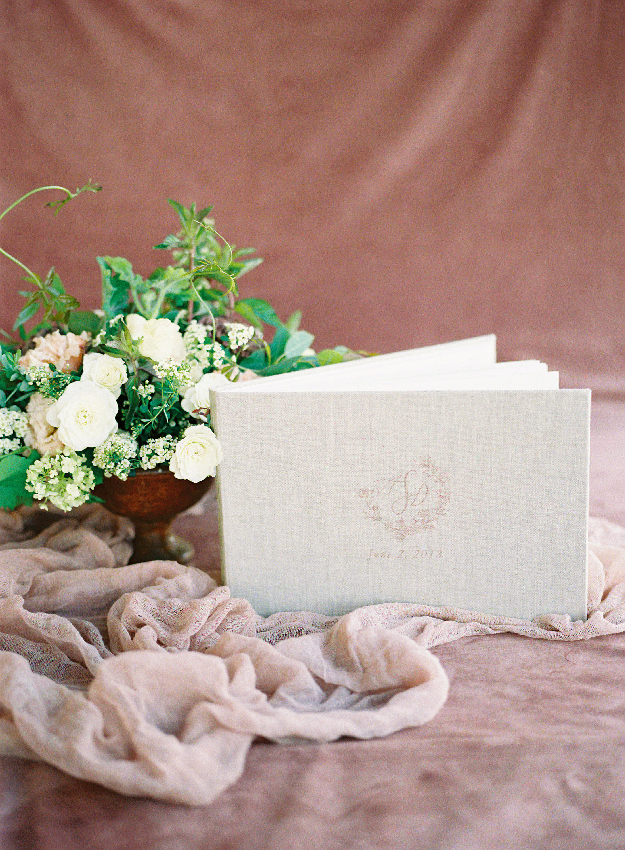 linen cover wedding guestbook with white flowers