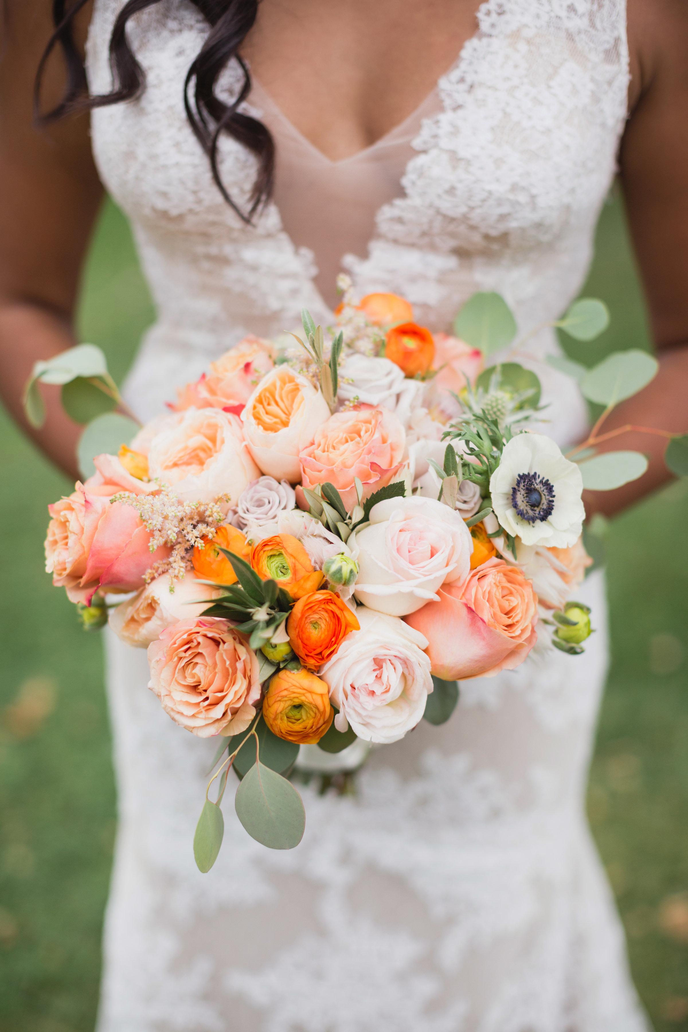 orange and white floral wedding bouquet