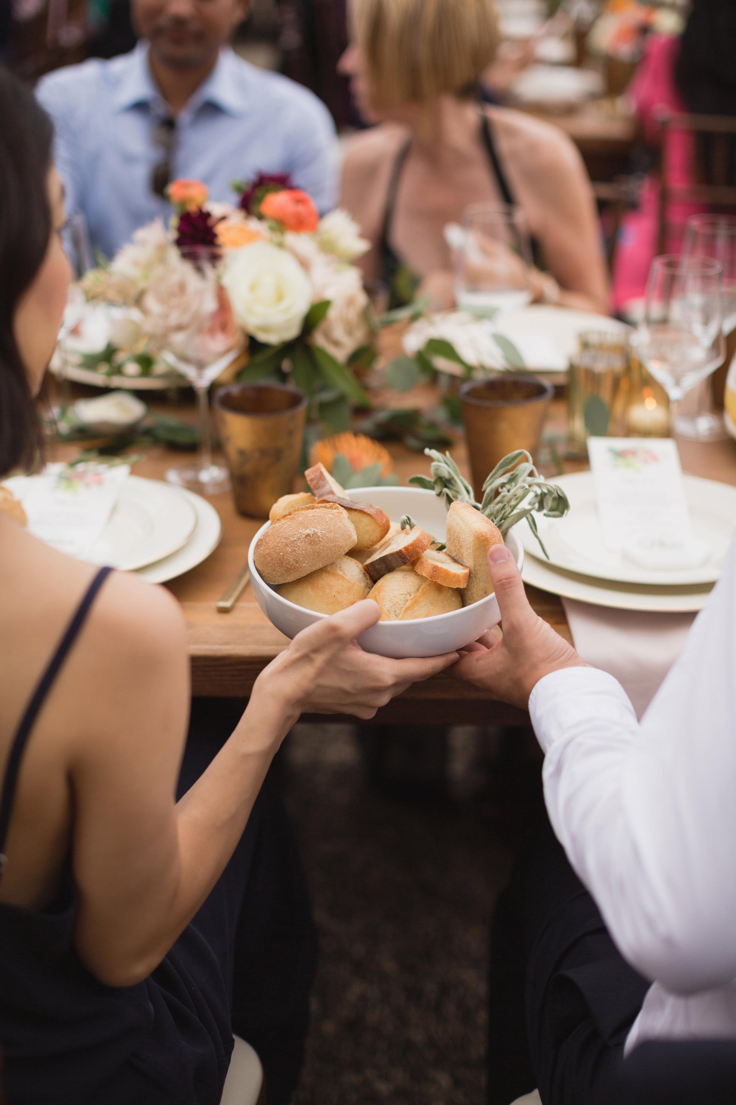 california indian jewish wedding dinner guests sharing bread