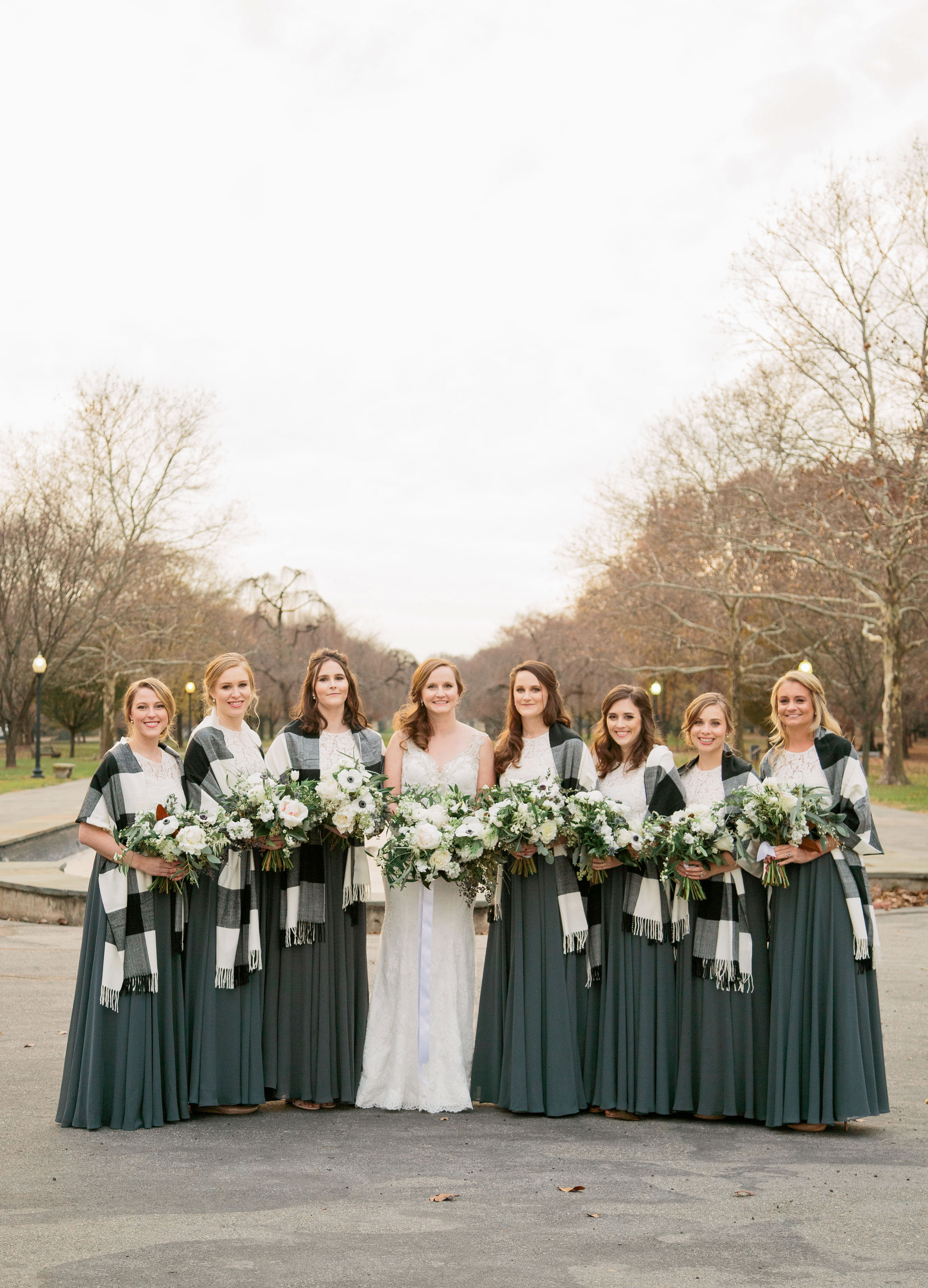bride and bridesmaids white lace tops dark green skirts
