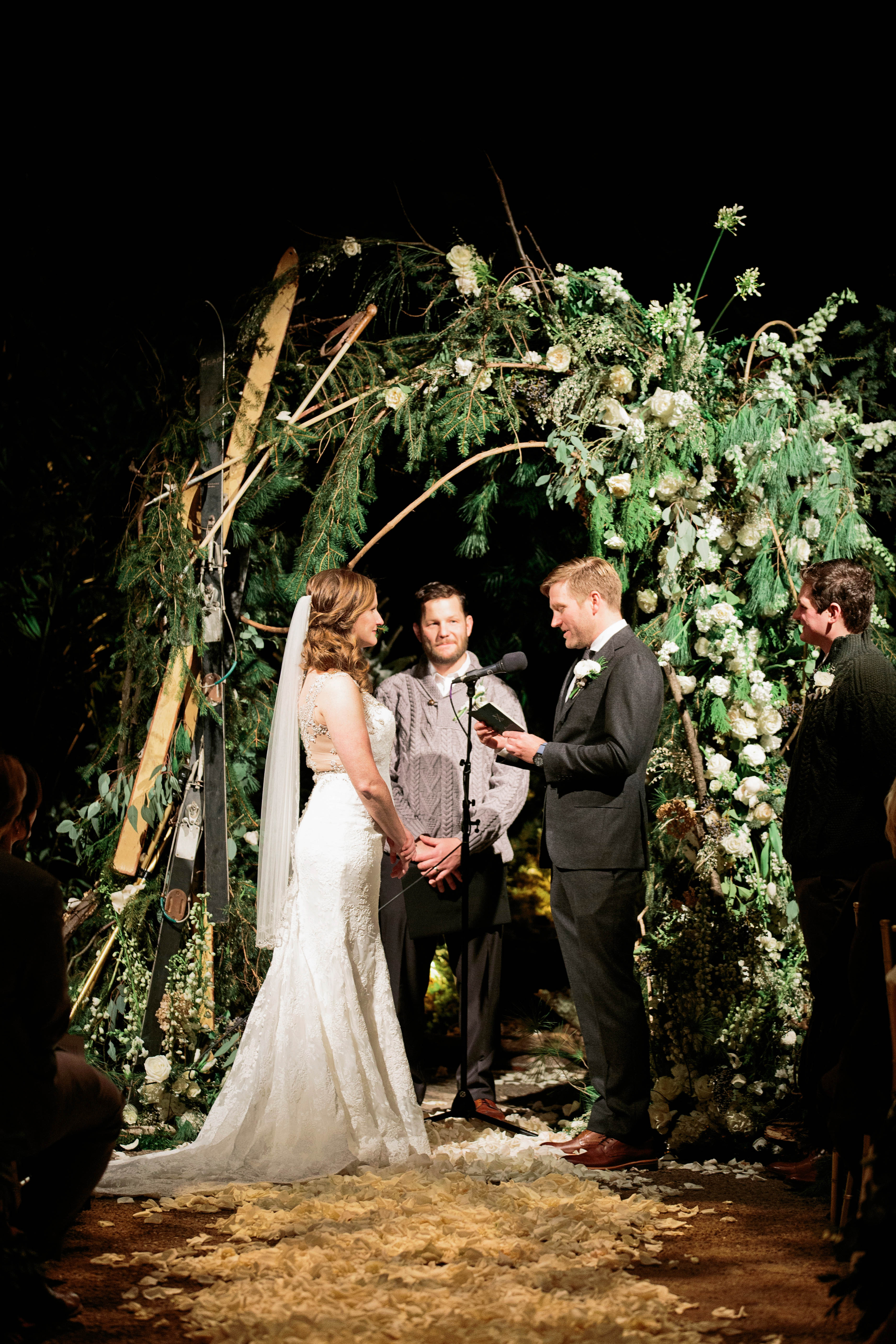 wedding ceremony evening vow reading with candle light