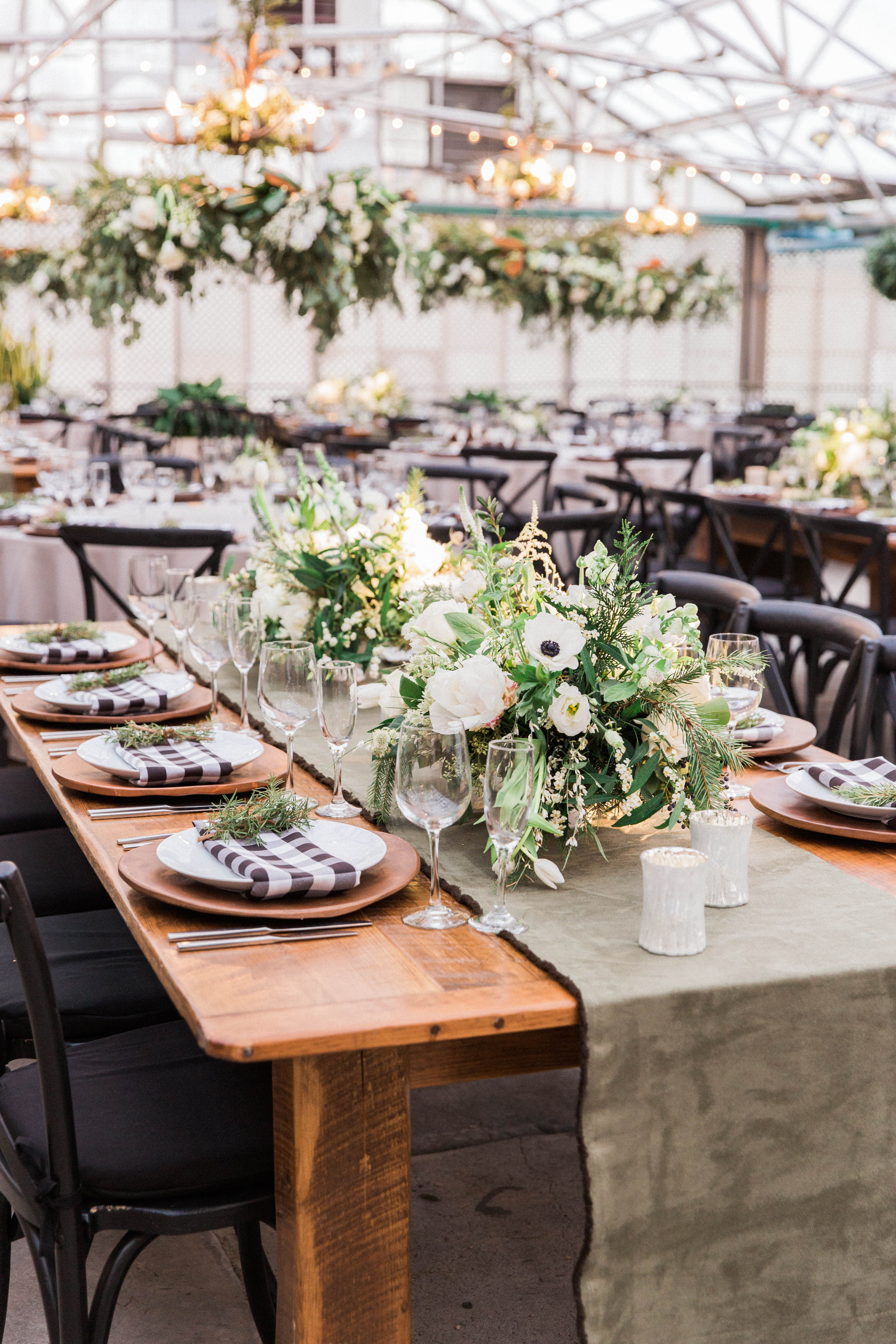 reception tables place setting with white floral arrangements