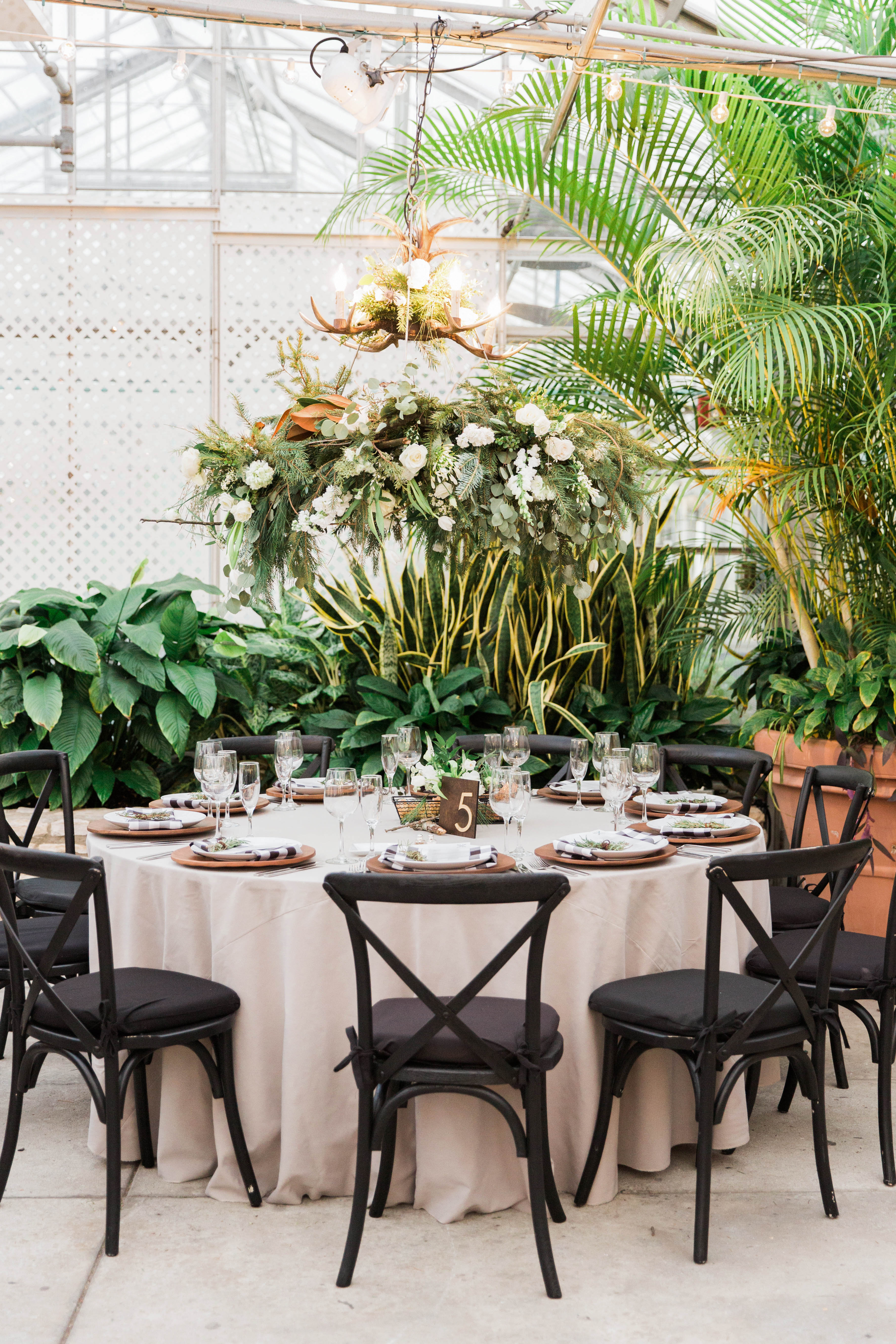 round tables taupe draped linen wood lanterns and table numbers