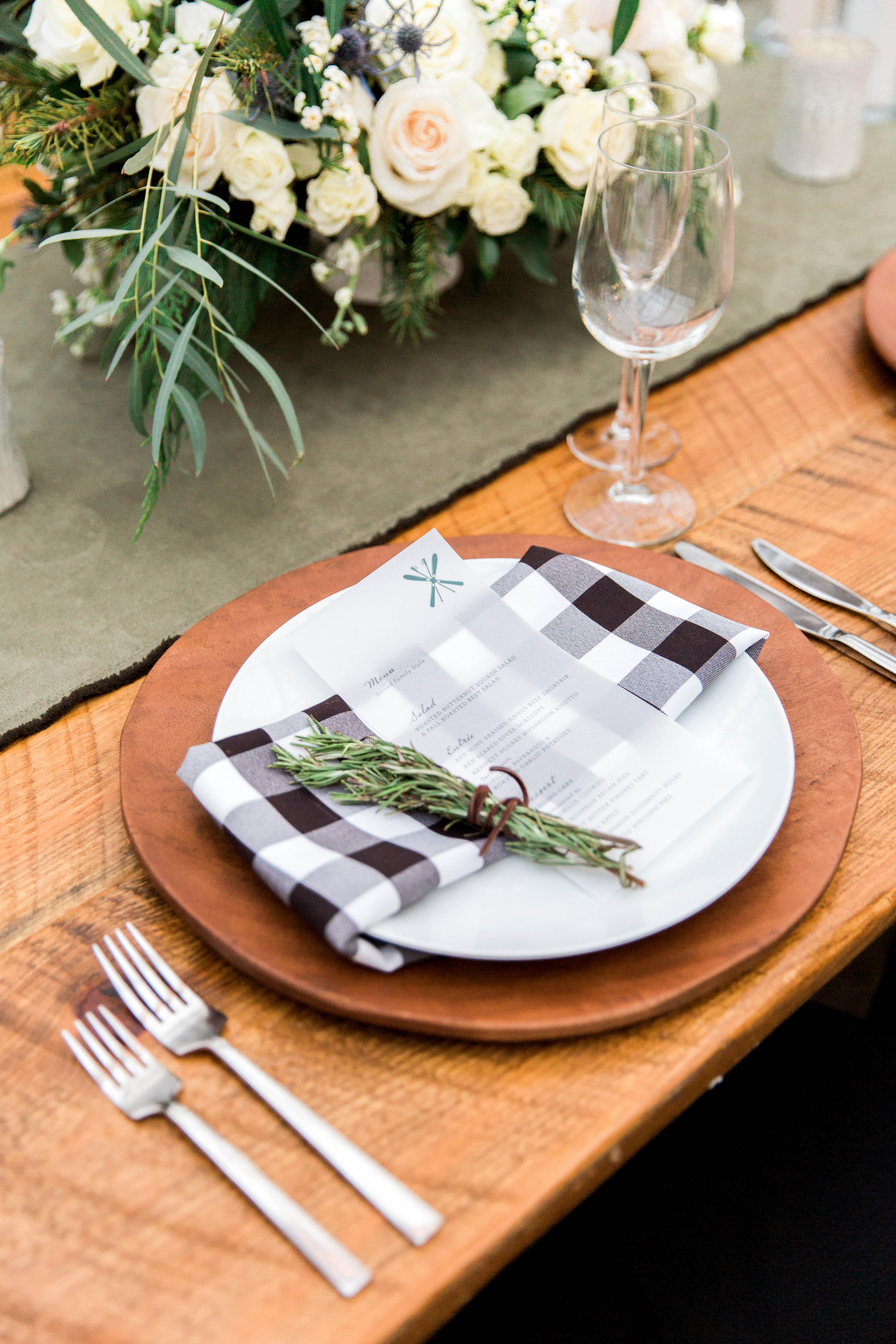 wedding reception place setting acacia wood buffalo check napkins
