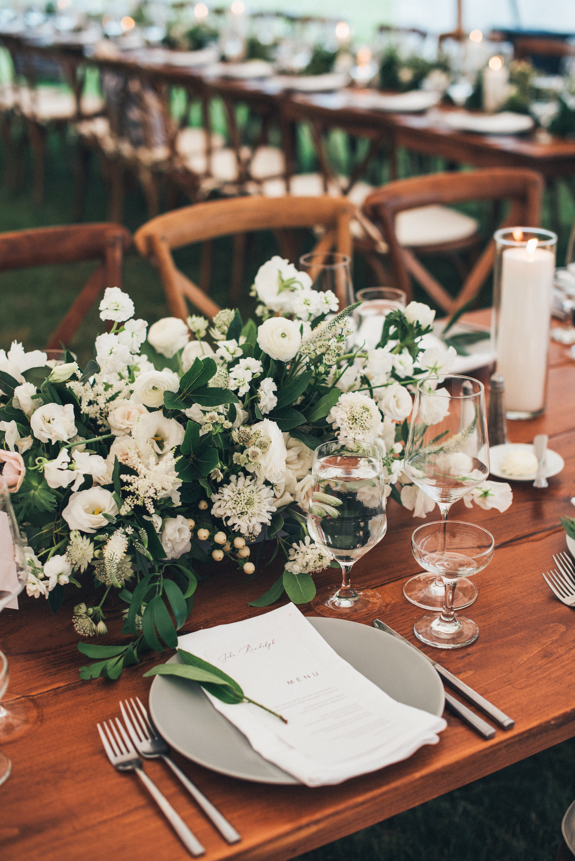 wedding reception table pacesetting white flowers