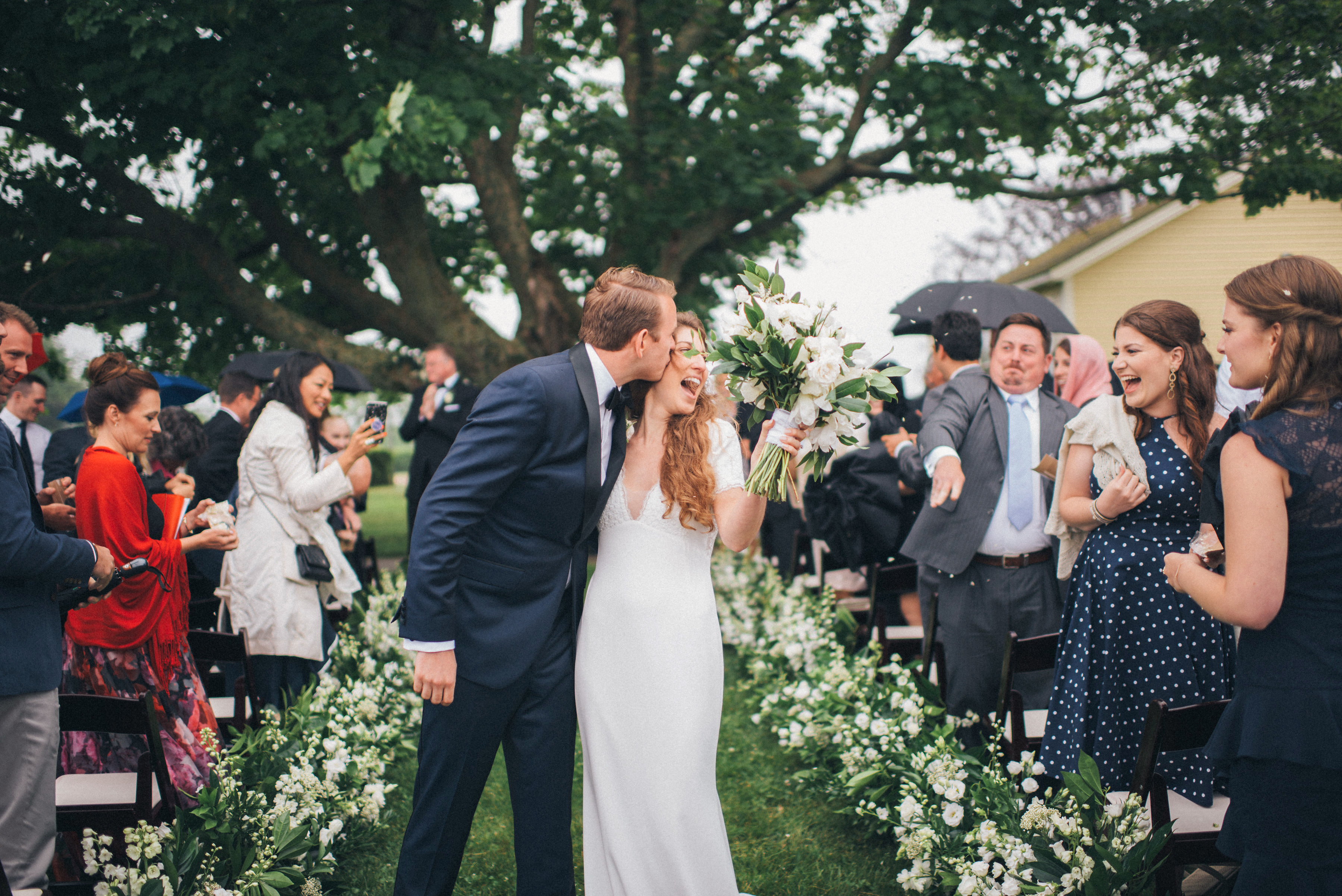 bride groom wedding recessional kiss