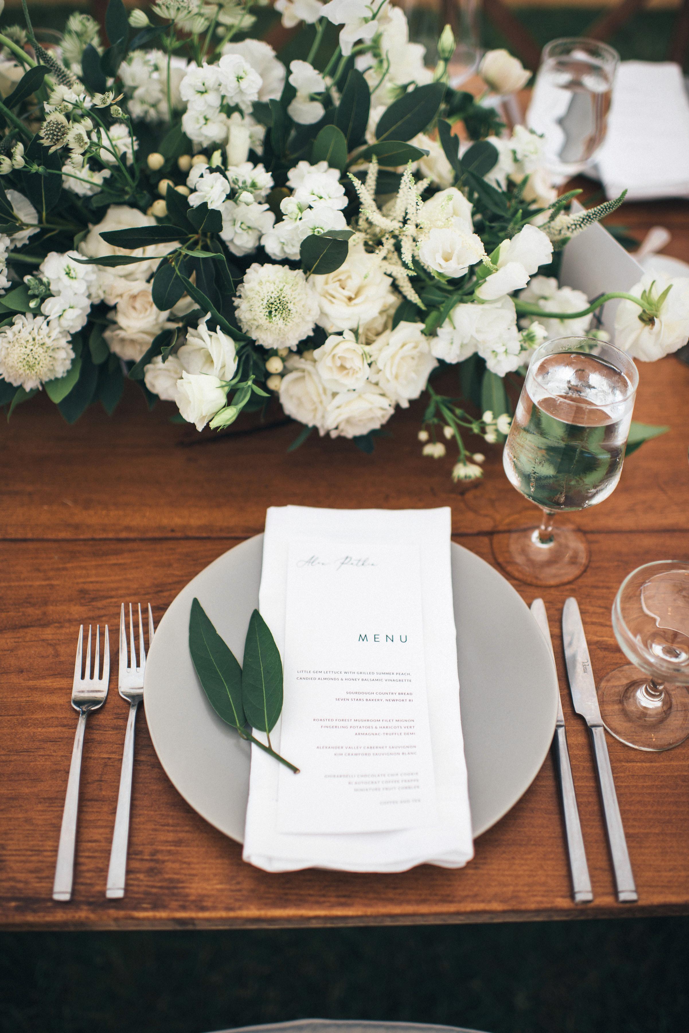 wedding reception menu table setting white floral centerpiece