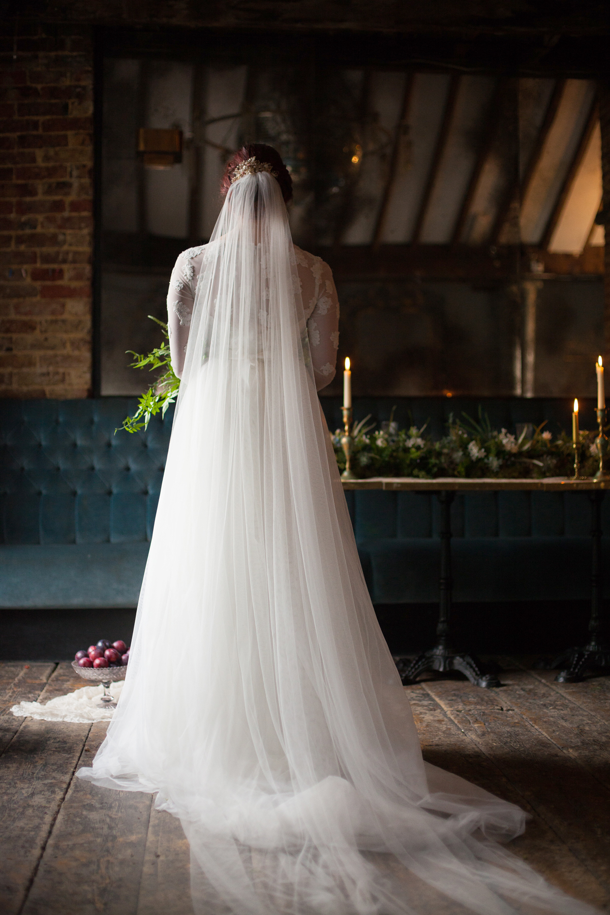 back of bride wearing long veil