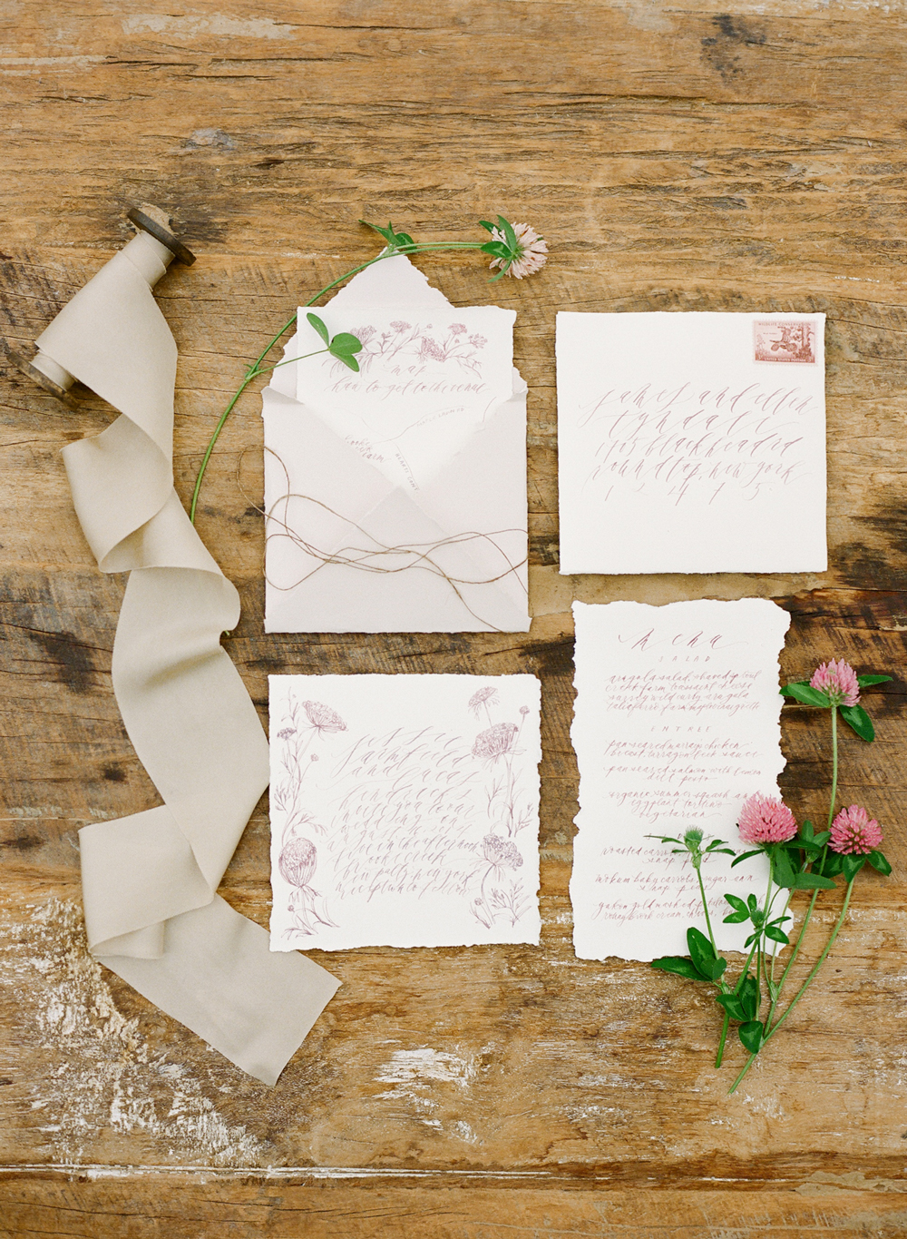 purple floral illustrated and deckled-edge stationary suite