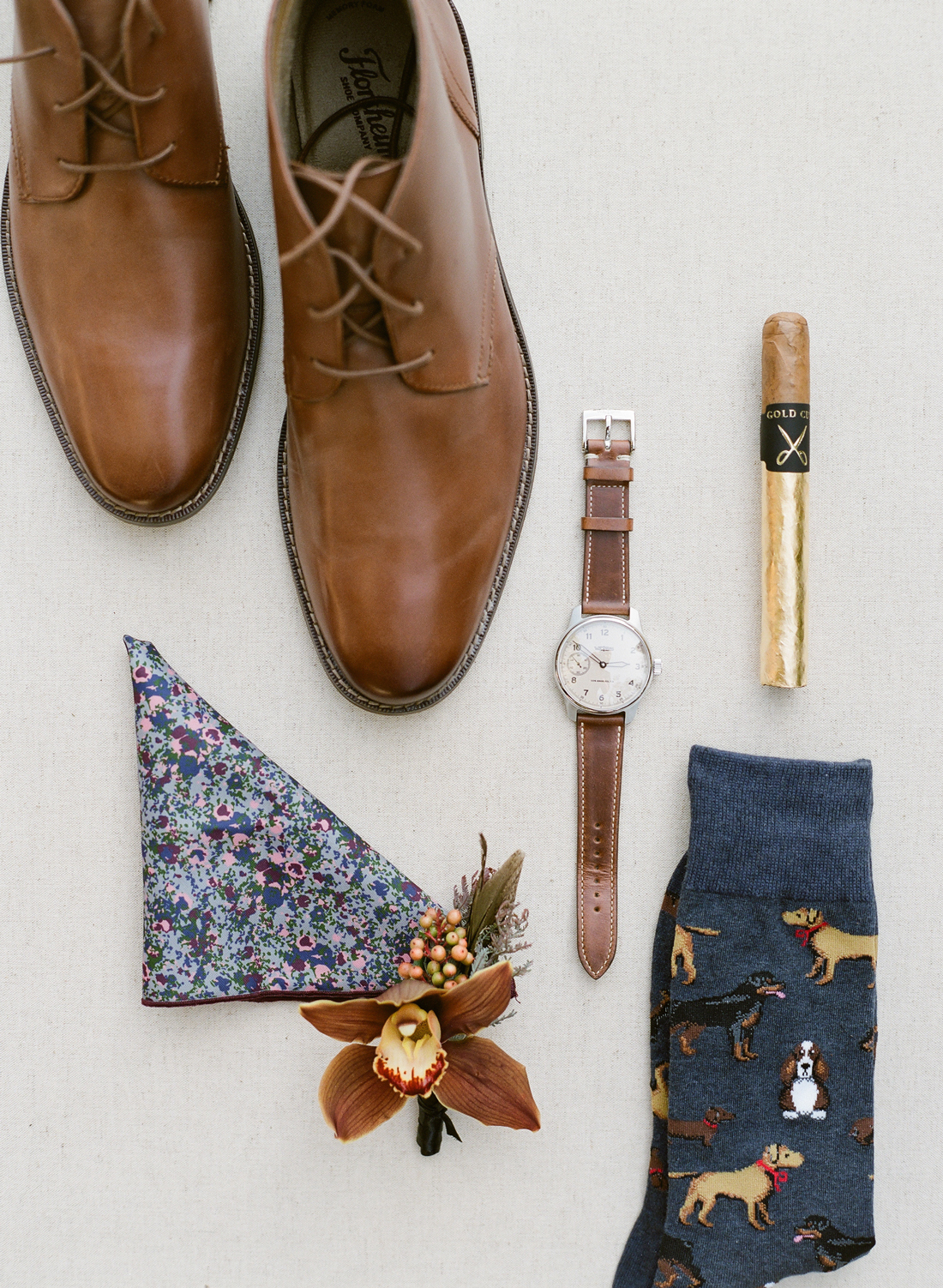 floral print pocket square, dog print socks, brown leather dress shoes and watch