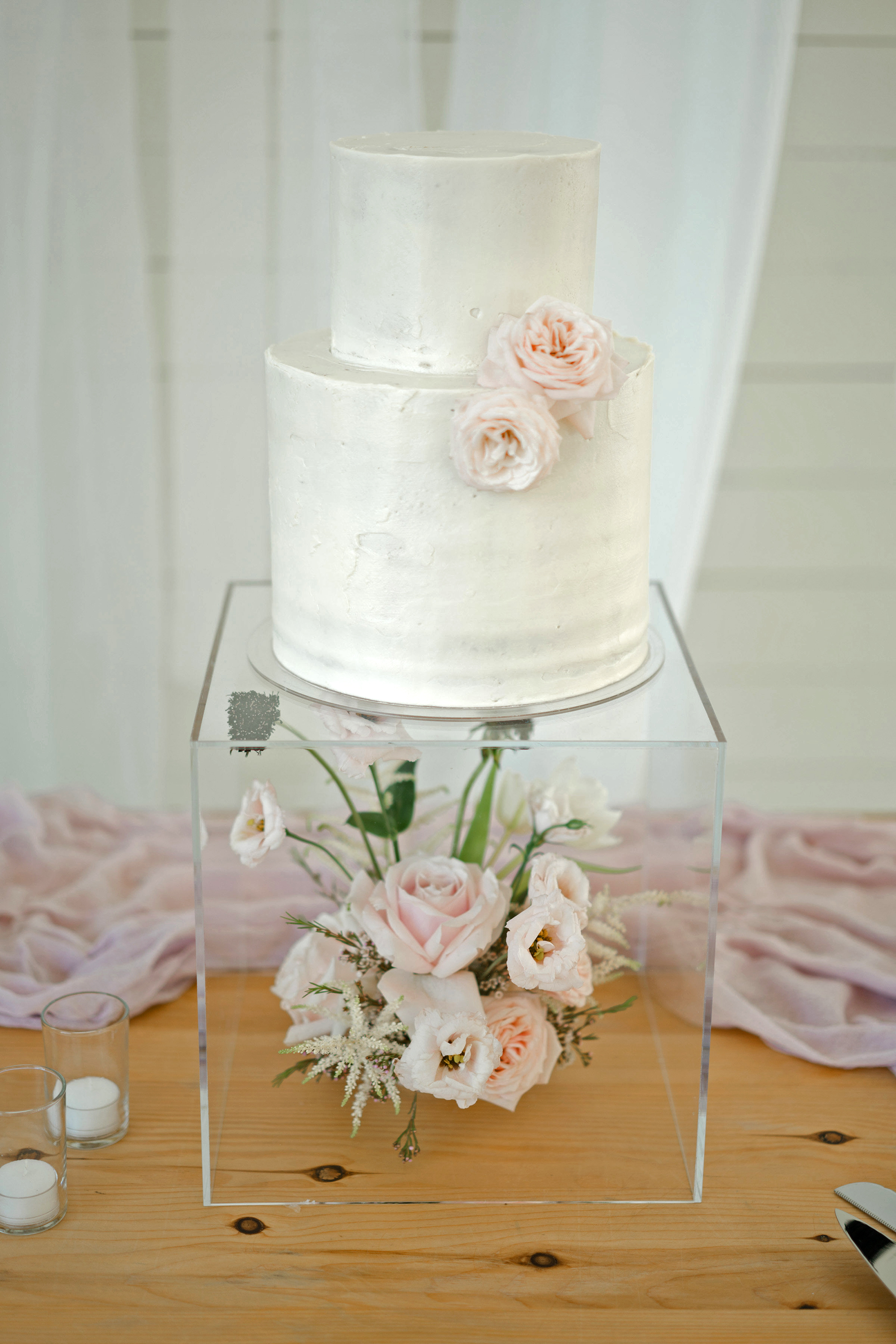 brittany peter wedding cake with light pink flowers