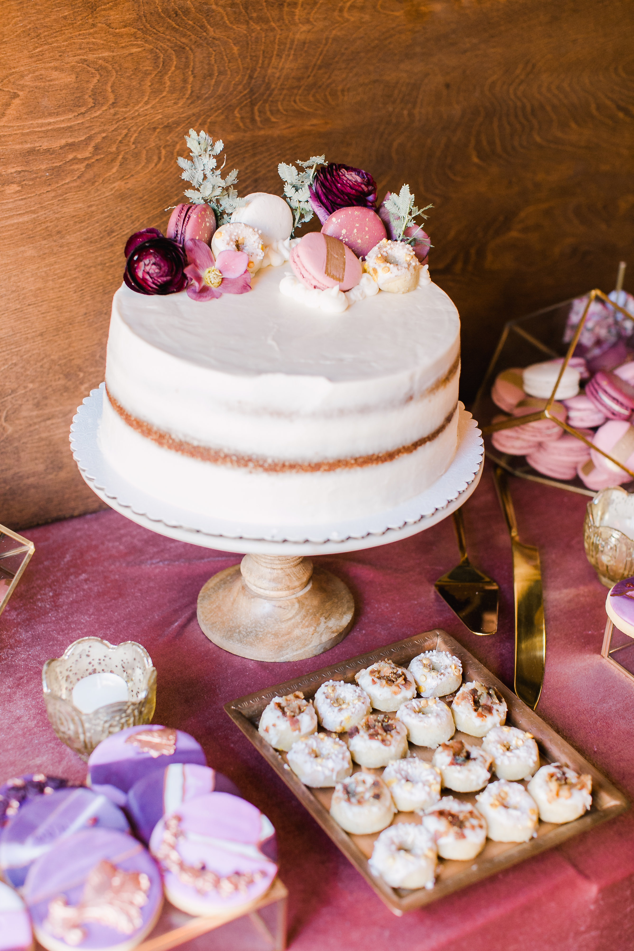 naked cake topped with macarons