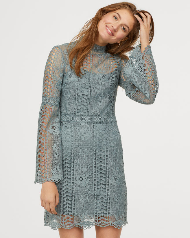 short blue gray lacy dress with trumpet sleeves and high neck collar