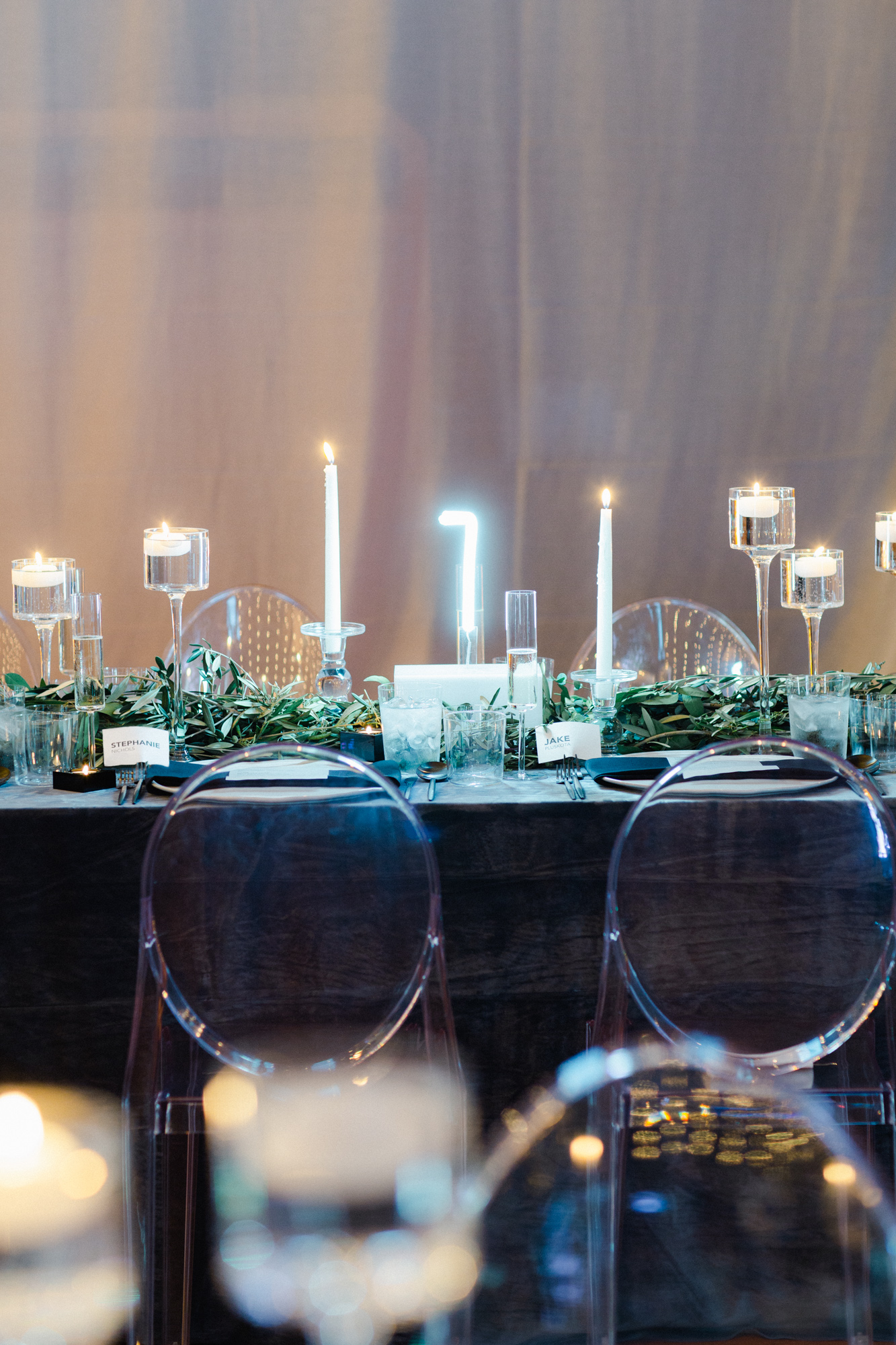 wedding reception table setting with candles black table cloth