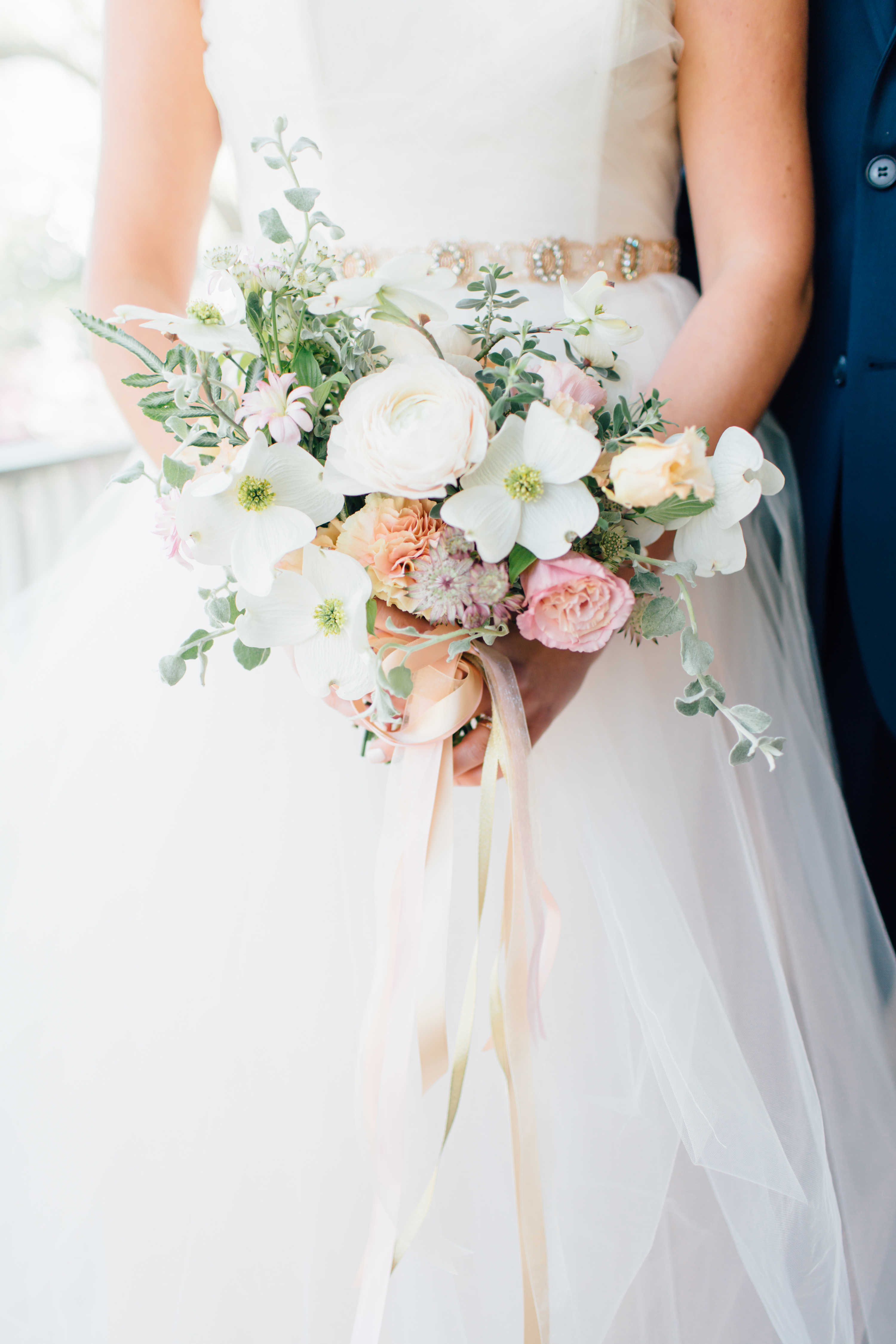 bride with colorful dogwood bouquet