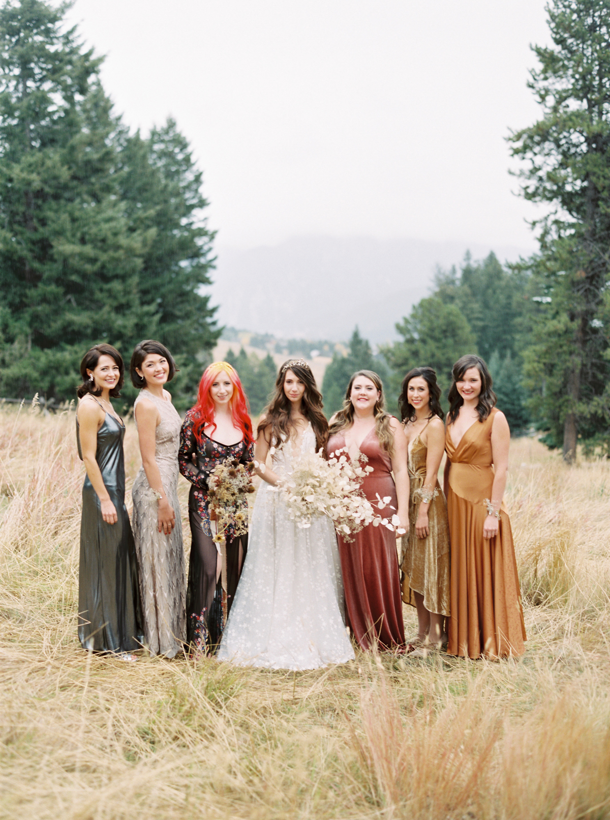 bride with bridesmaids wearing non-matching earth-tone gowns