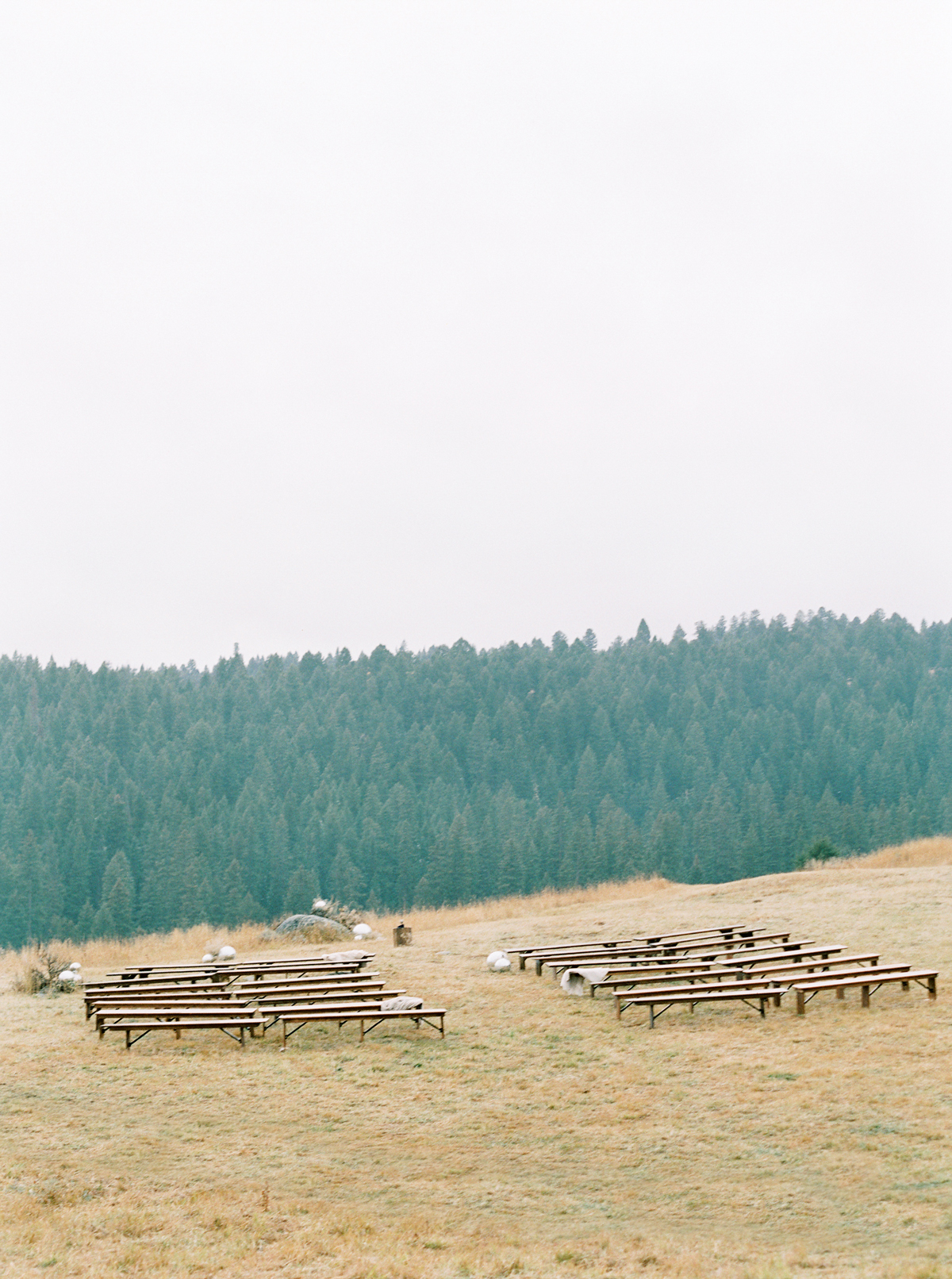 ceremony setup overlooking mountains and aisles lined with disco balls