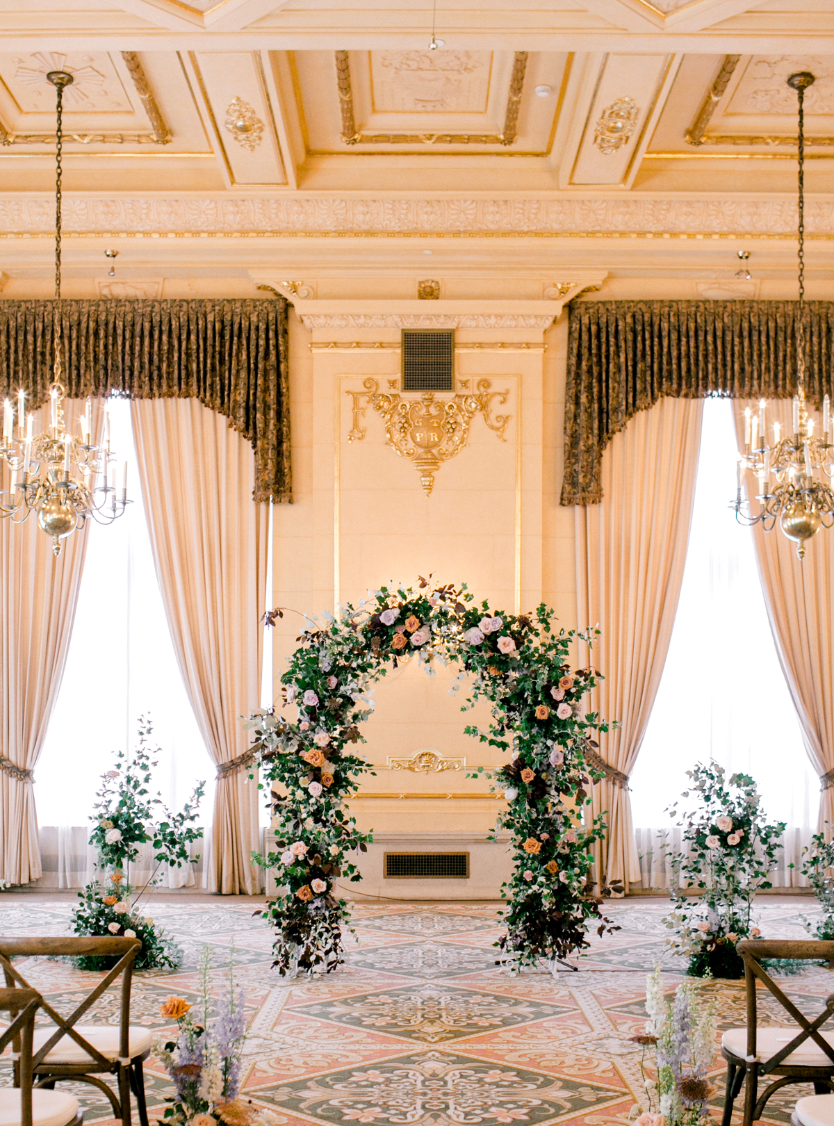 wedding ceremony setup ornate room decorated with flowers and flower arch
