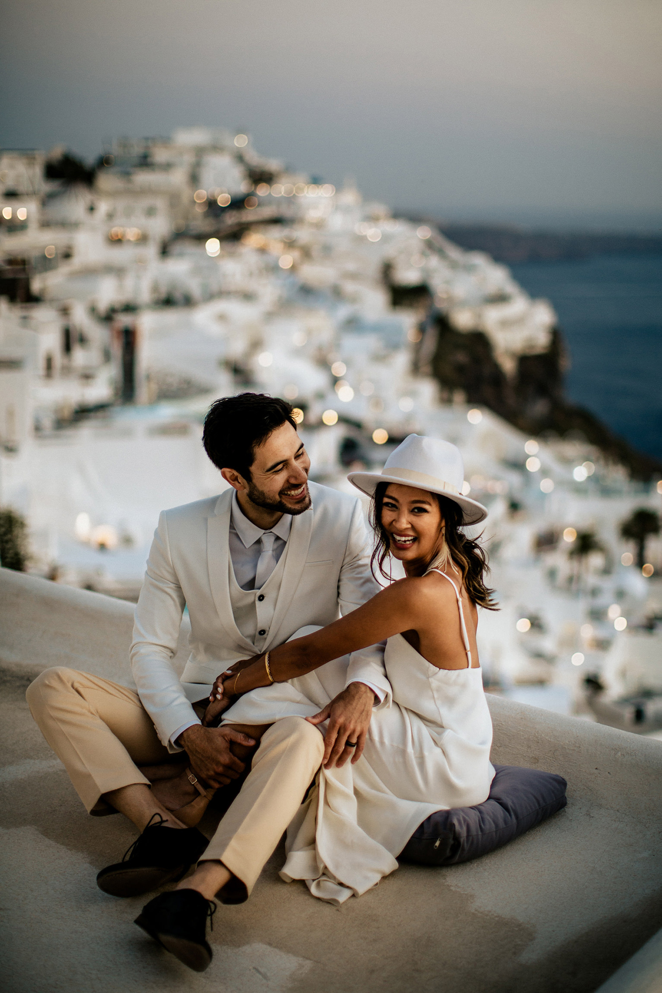 bride wearing white hat in greece