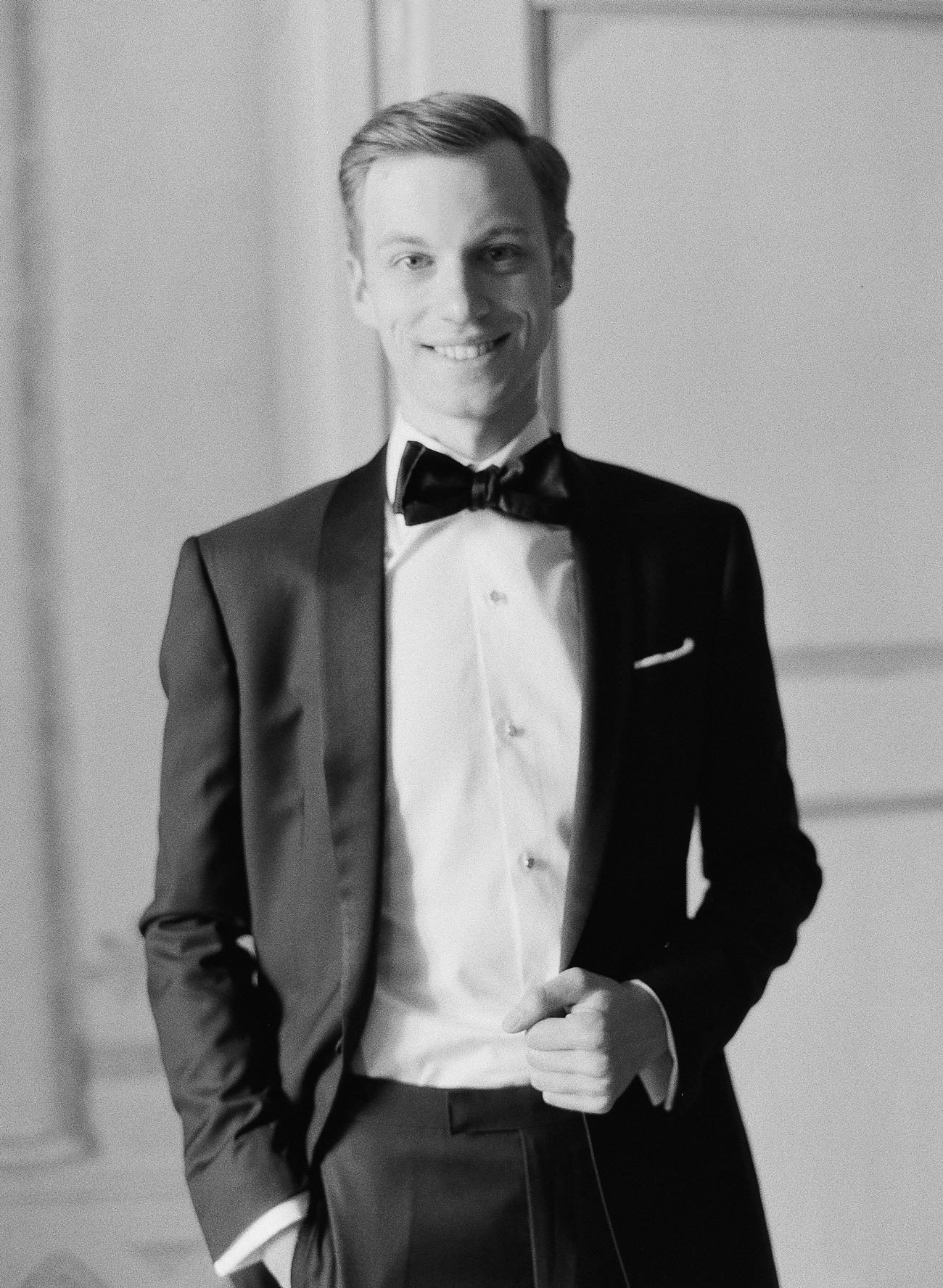 groom wearing custom midnight blue tuxedo