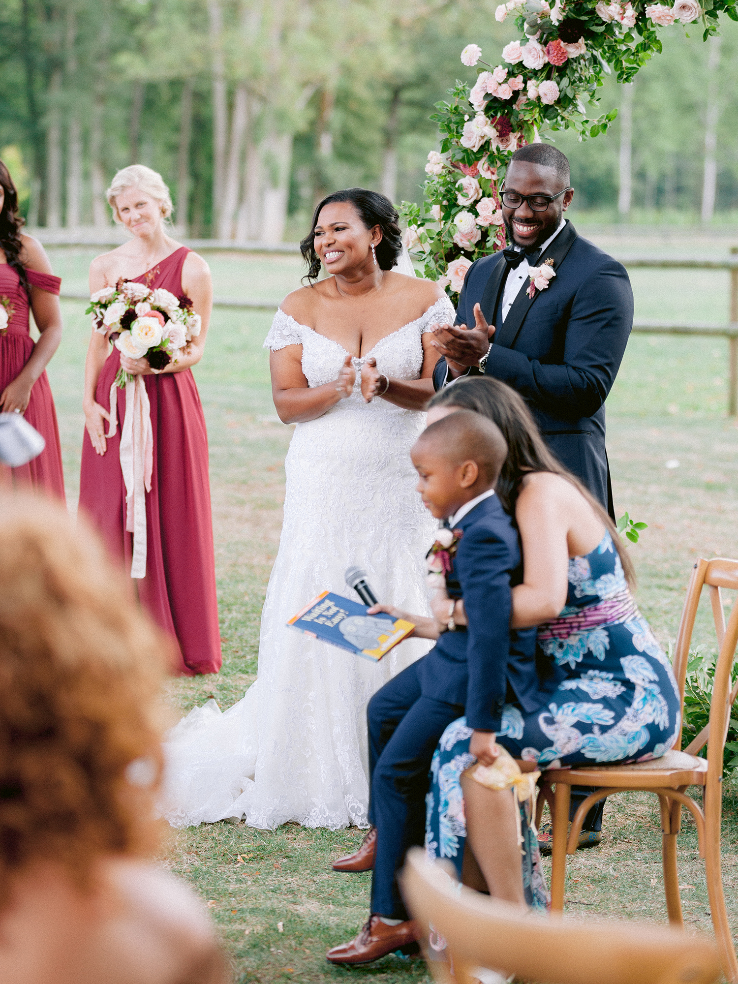 natalie elijah wedding ceremony couple at altar with child