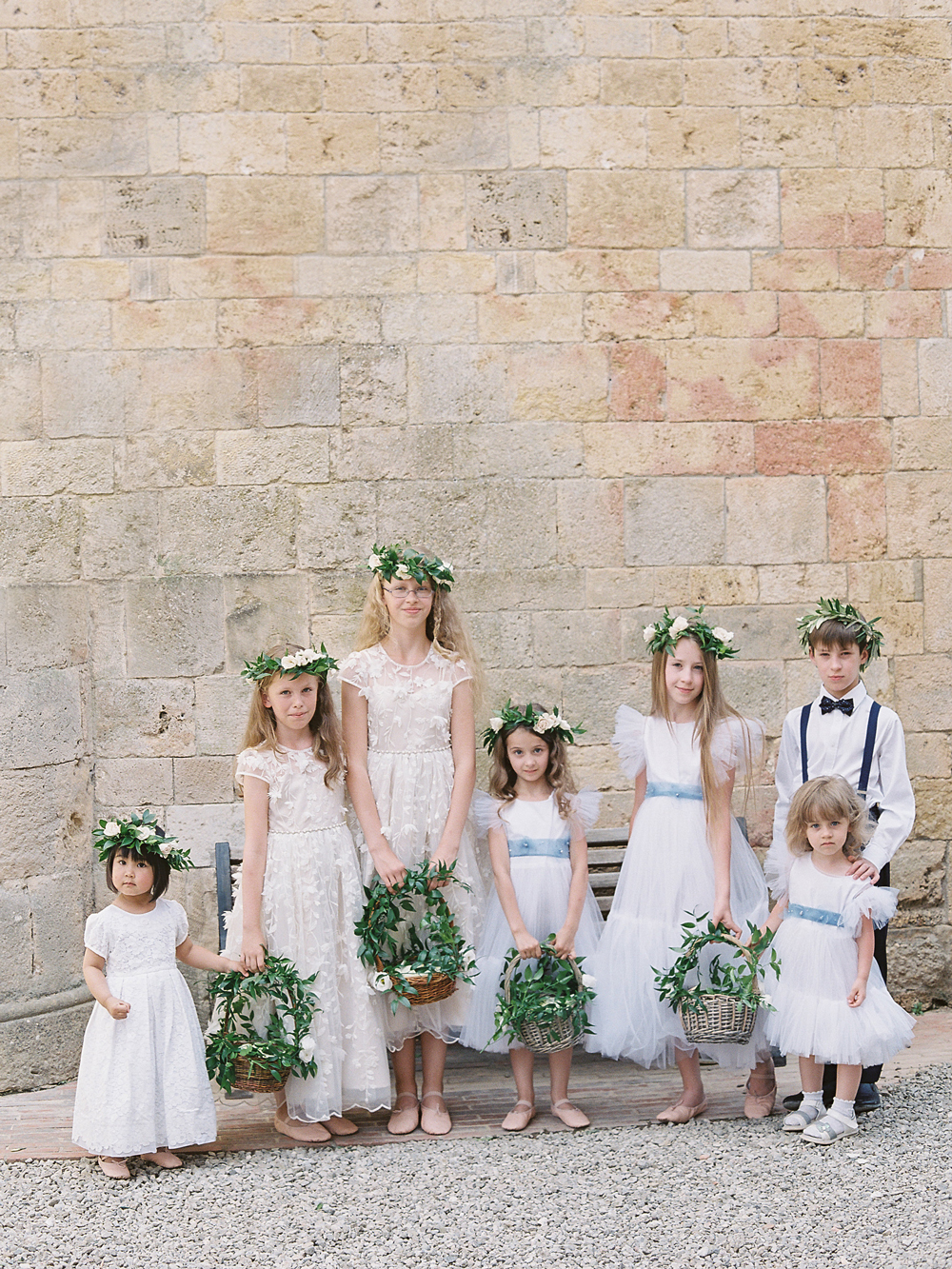 multiple flower girls in ivory white, tea length, cap sleeve dresses
