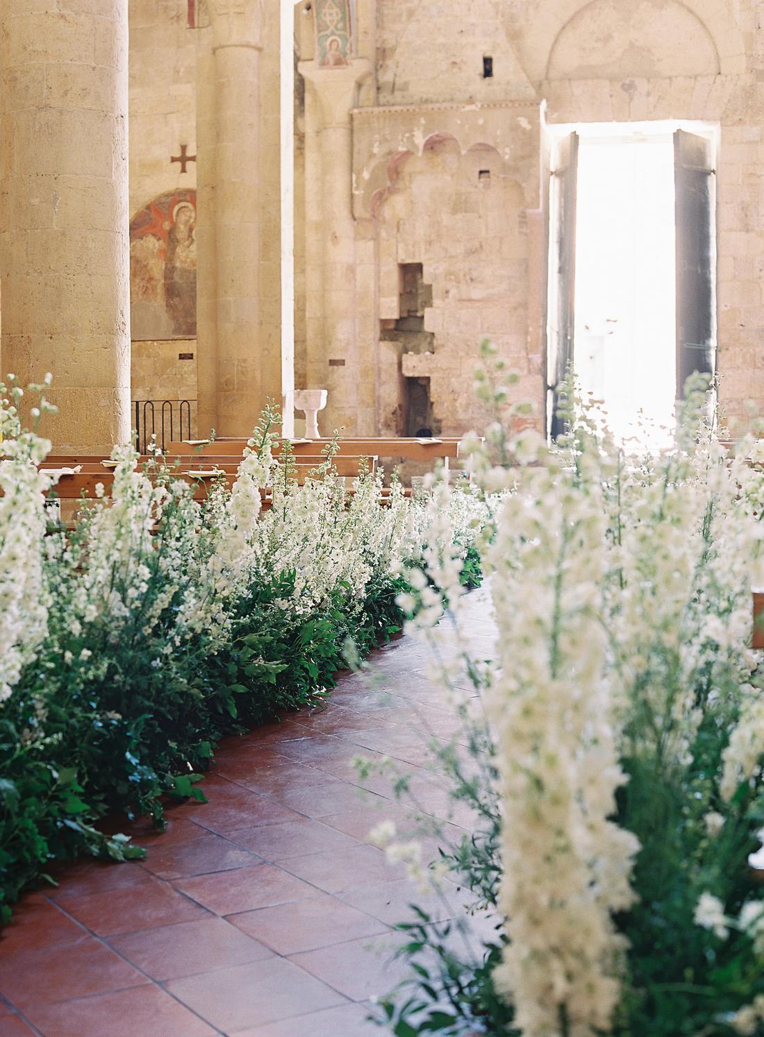 delphinium lined wedding ceremony church aisle