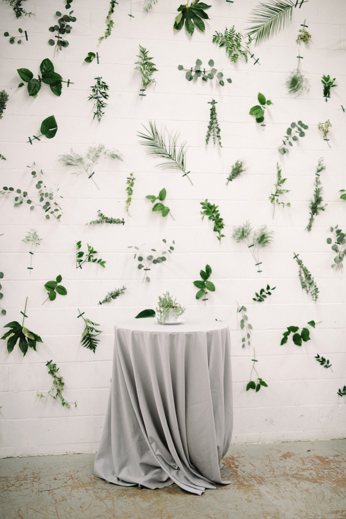 wedding reception decor leaves pressed to wall