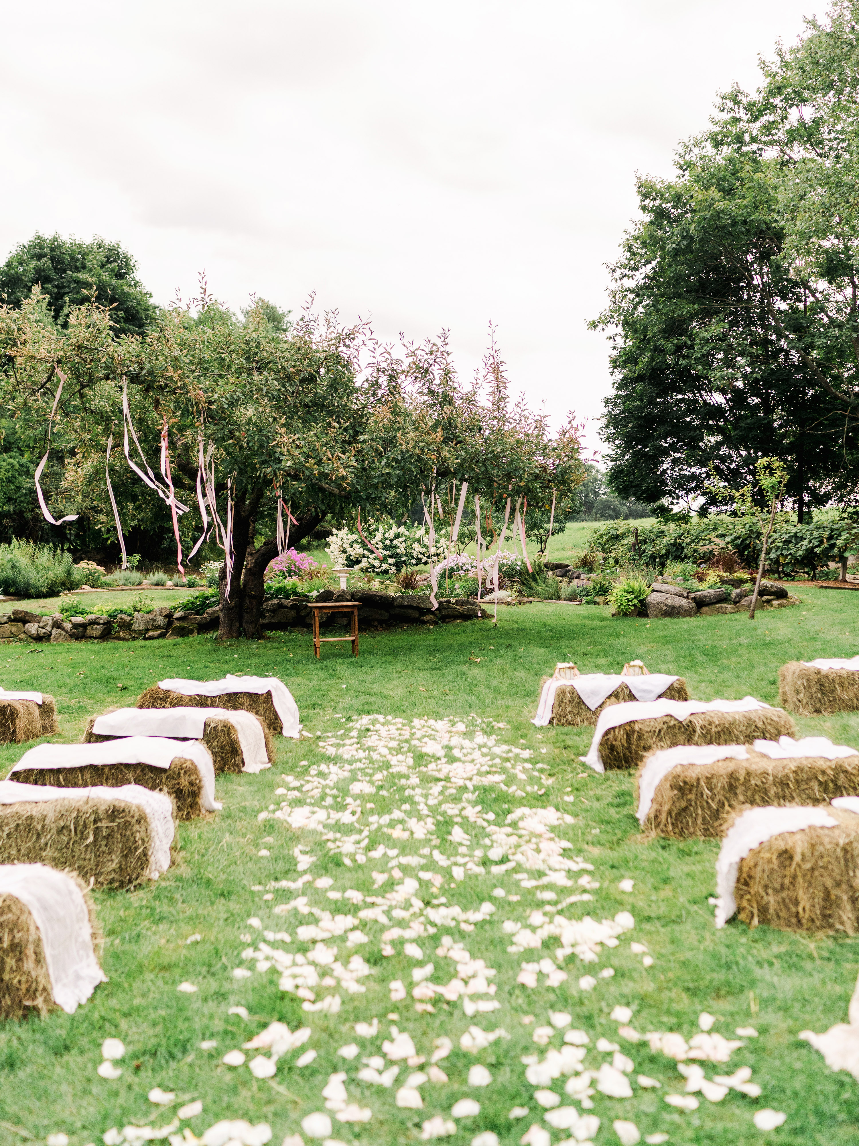 dayane collin wedding outdoor ceremony with hay seating