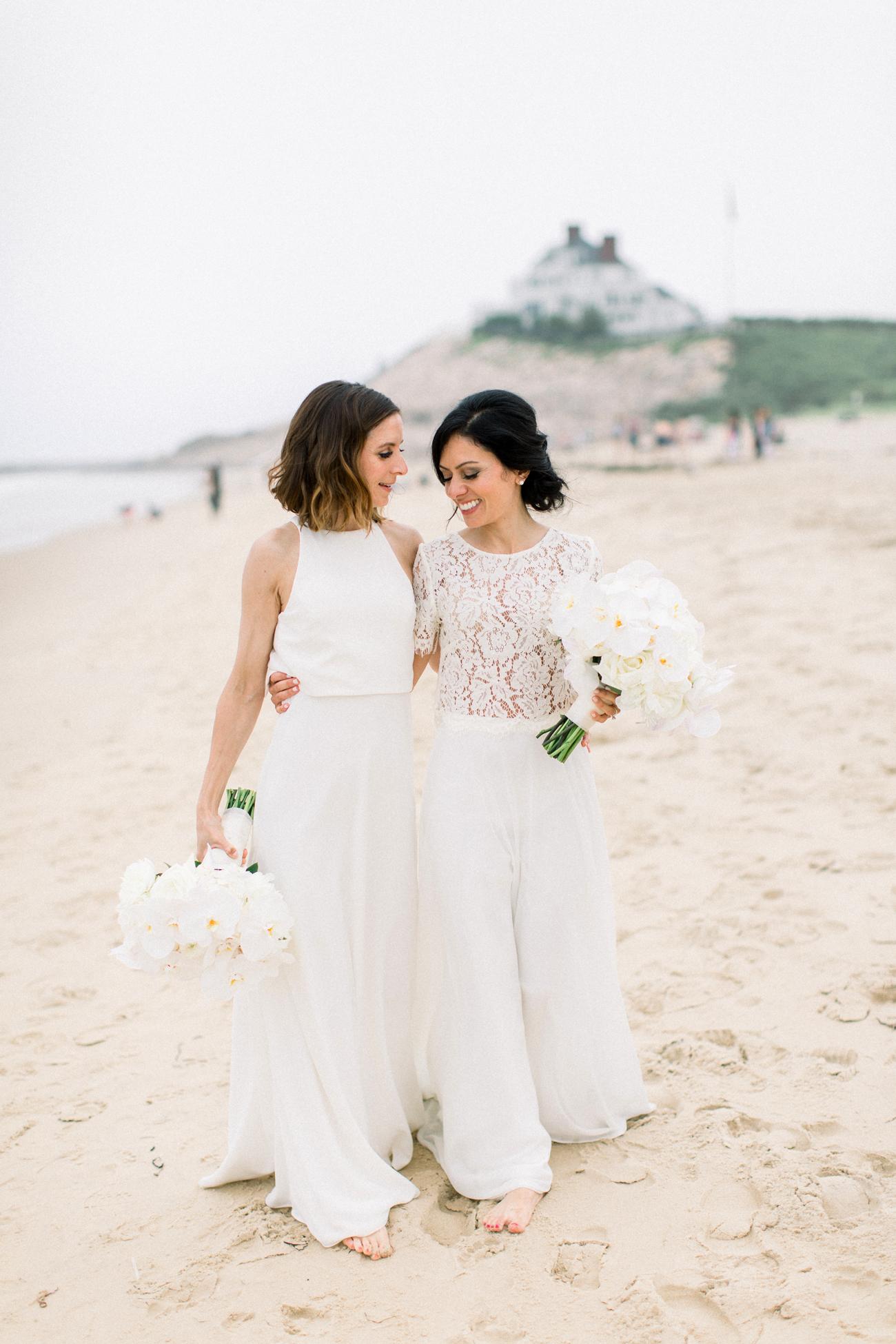 brides walk on ocean front beach