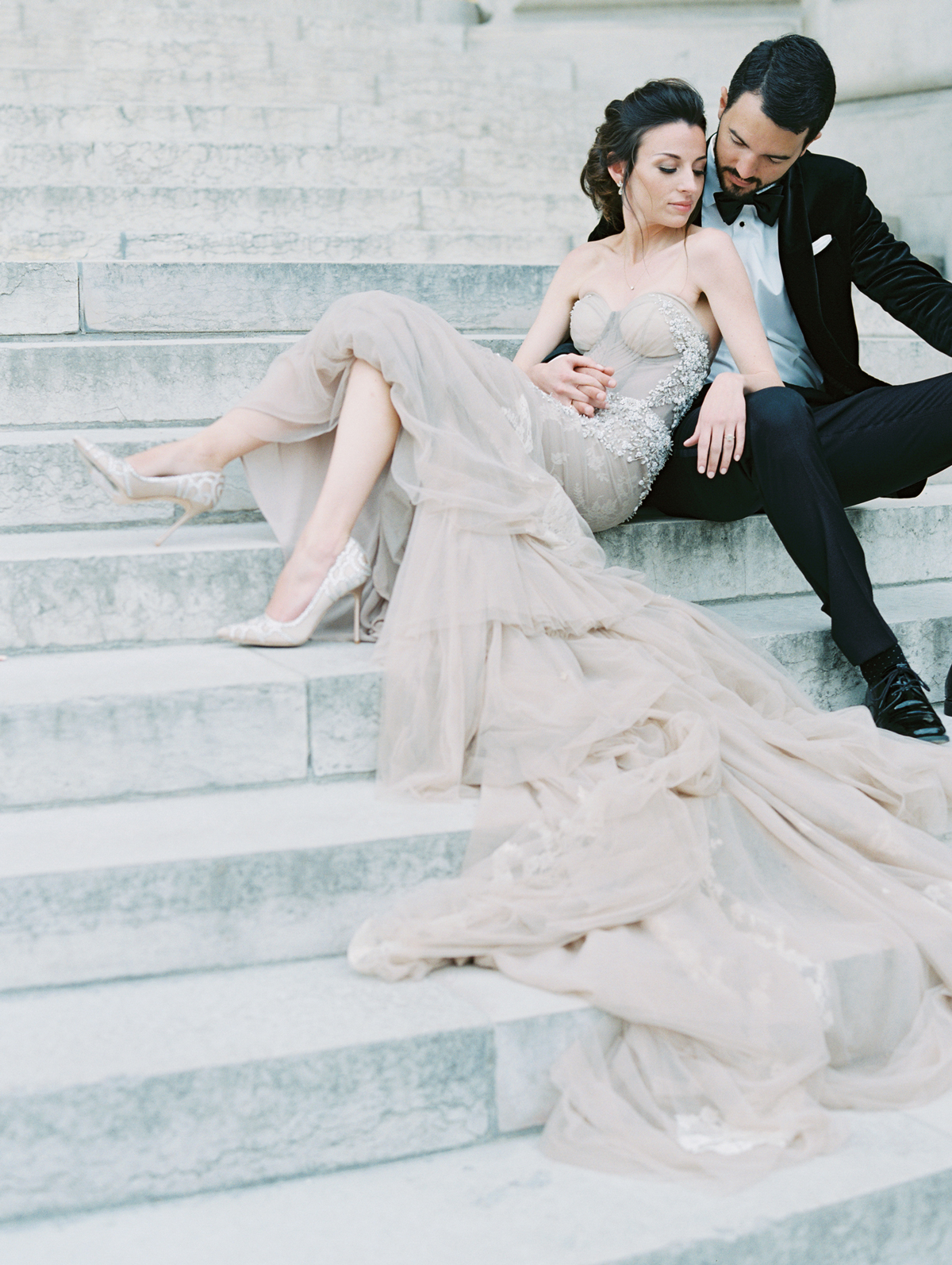 bride and groom sitting on steps