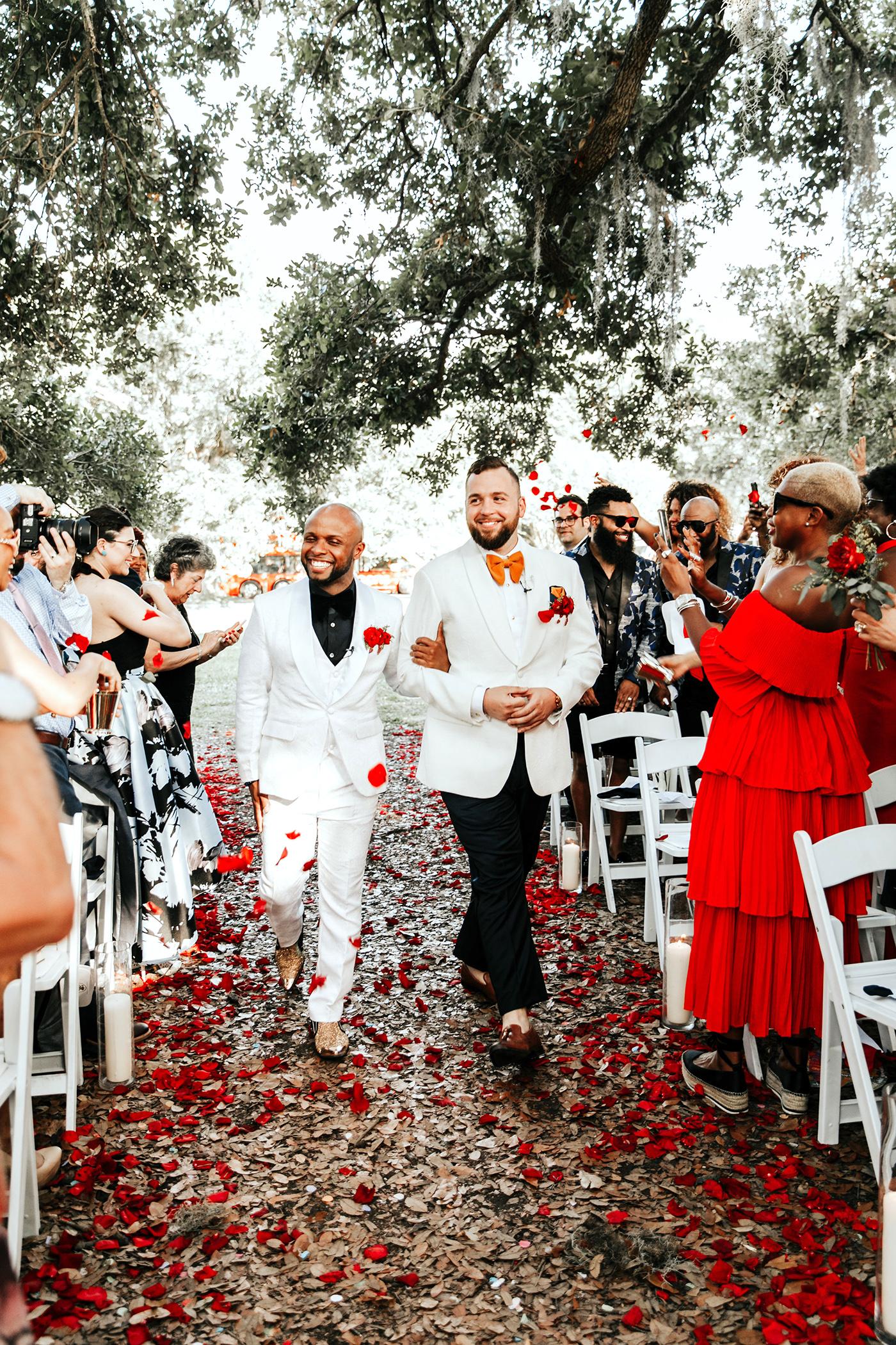 joe tim new orleans wedding grooms recessional petals