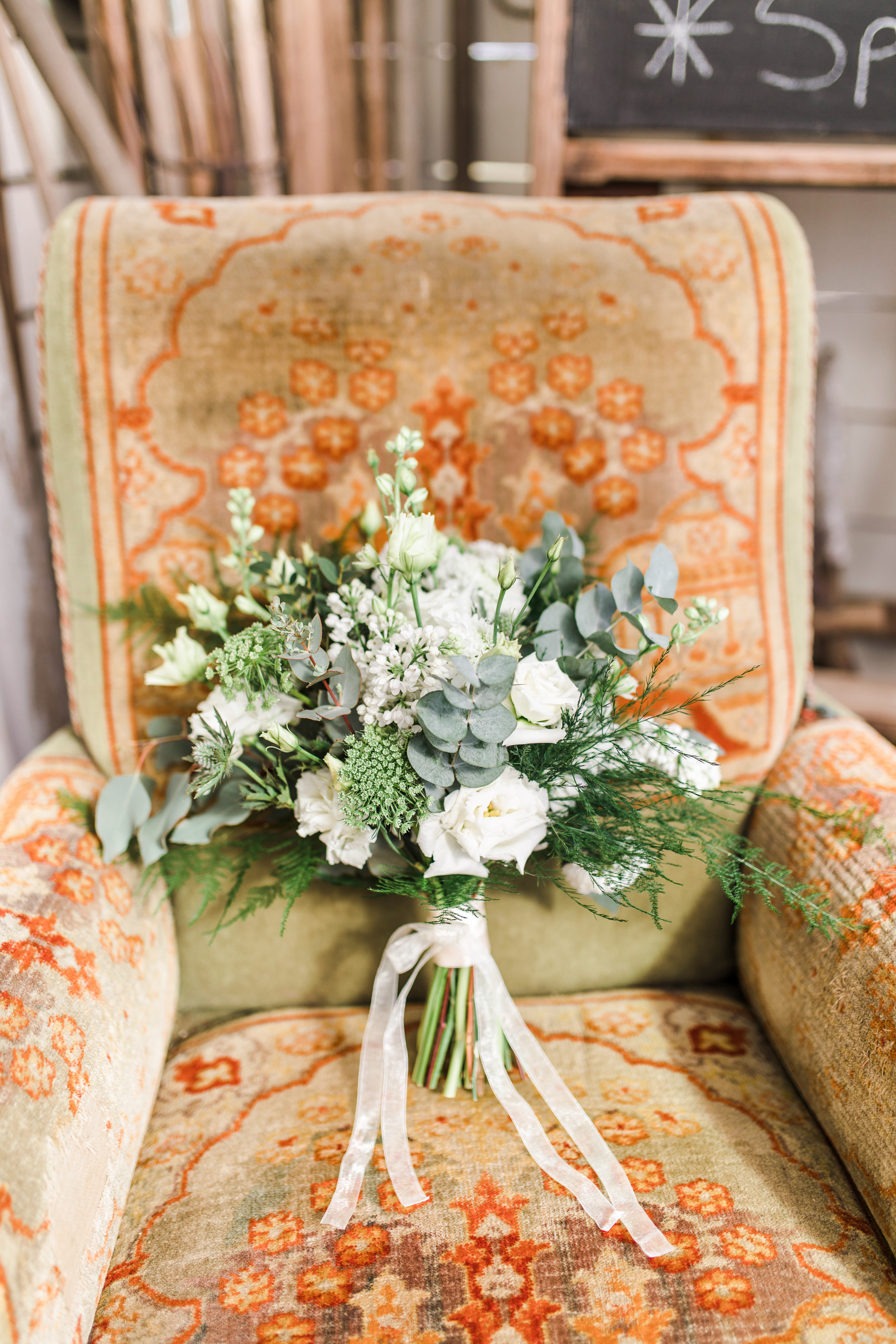 dill and eucalyptus white flower bouquet arrangement with white ribbon