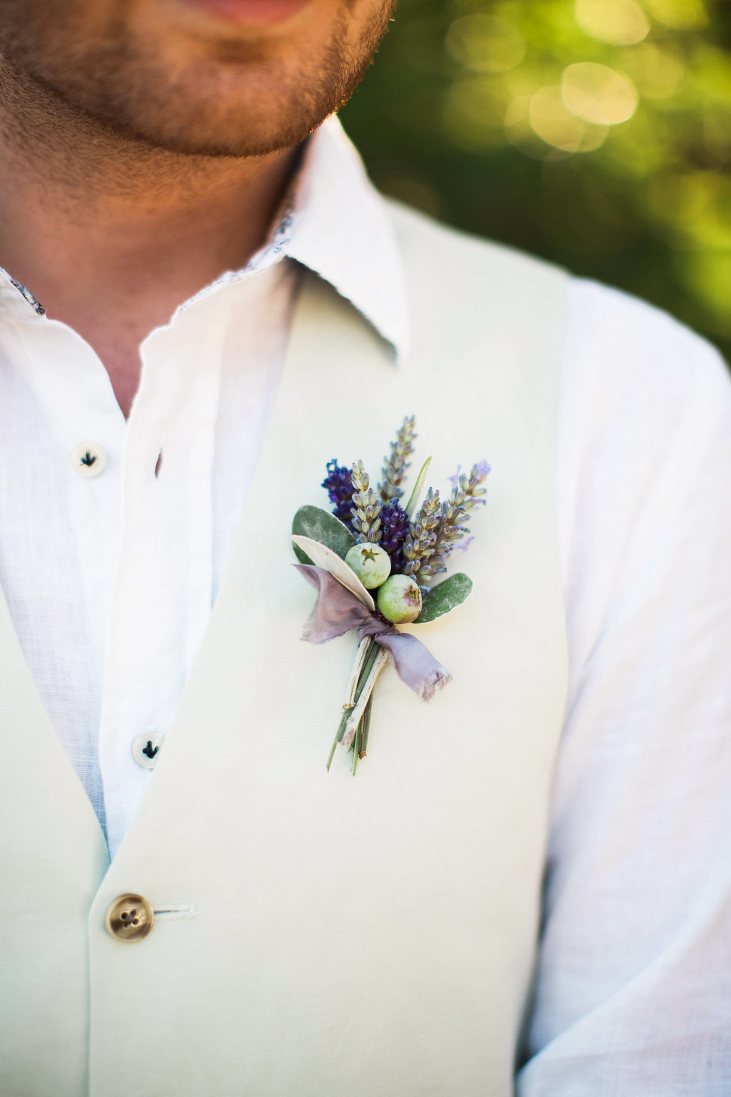 man with herbal boutonniere