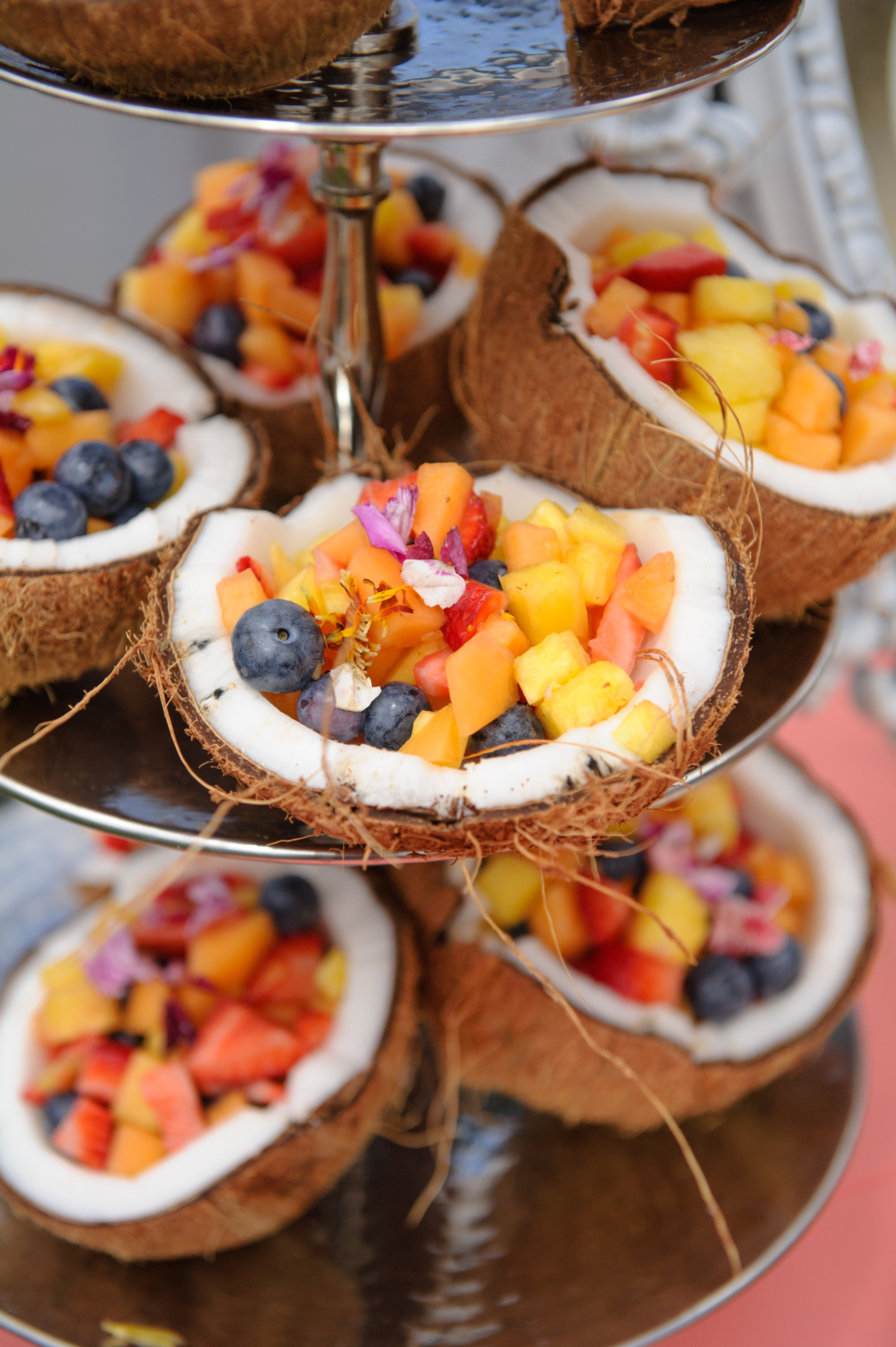 coconut bowls filled with mixed fruit