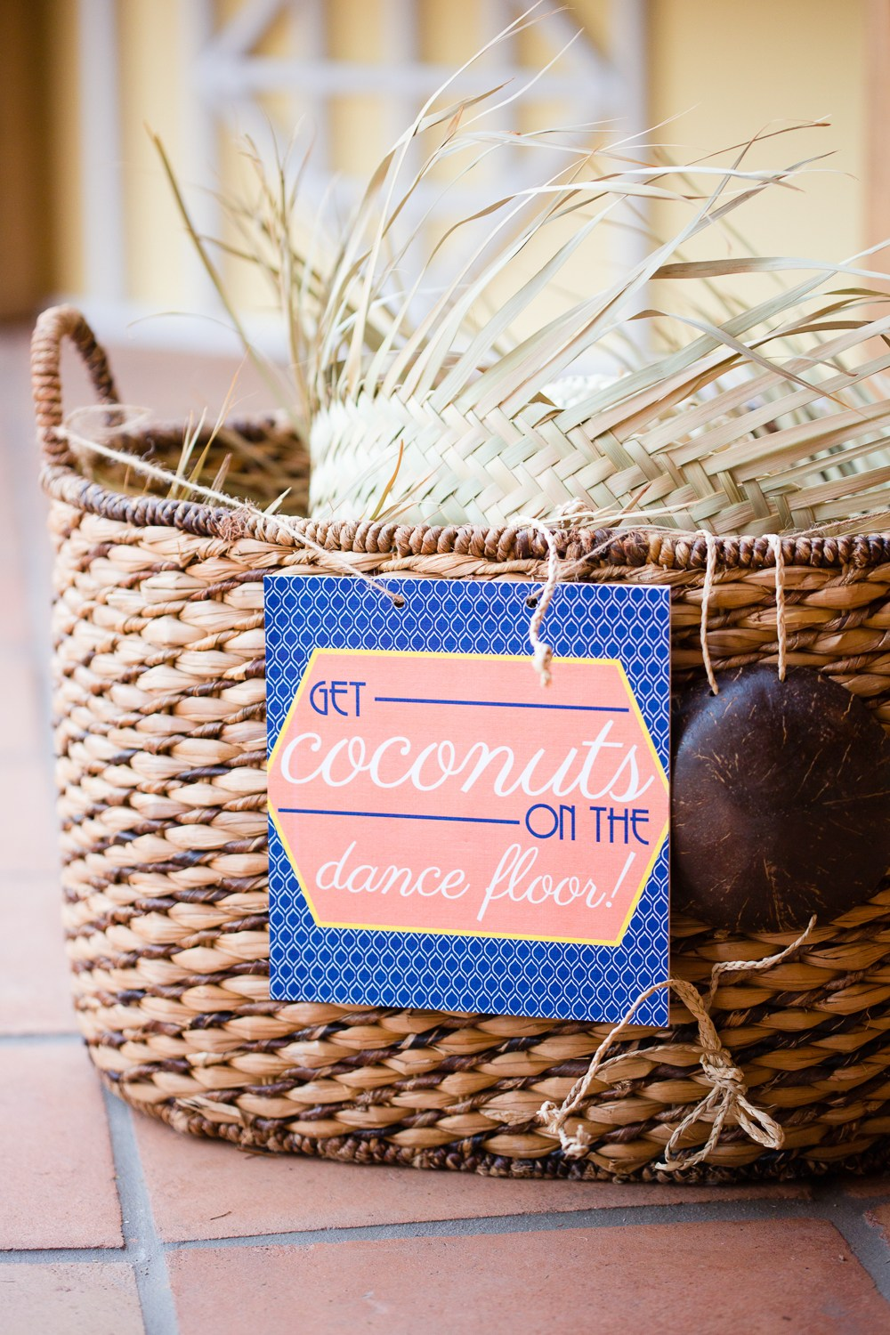 """woven basket with """"Get Coconuts on the Dance Floor!"""" sign"""