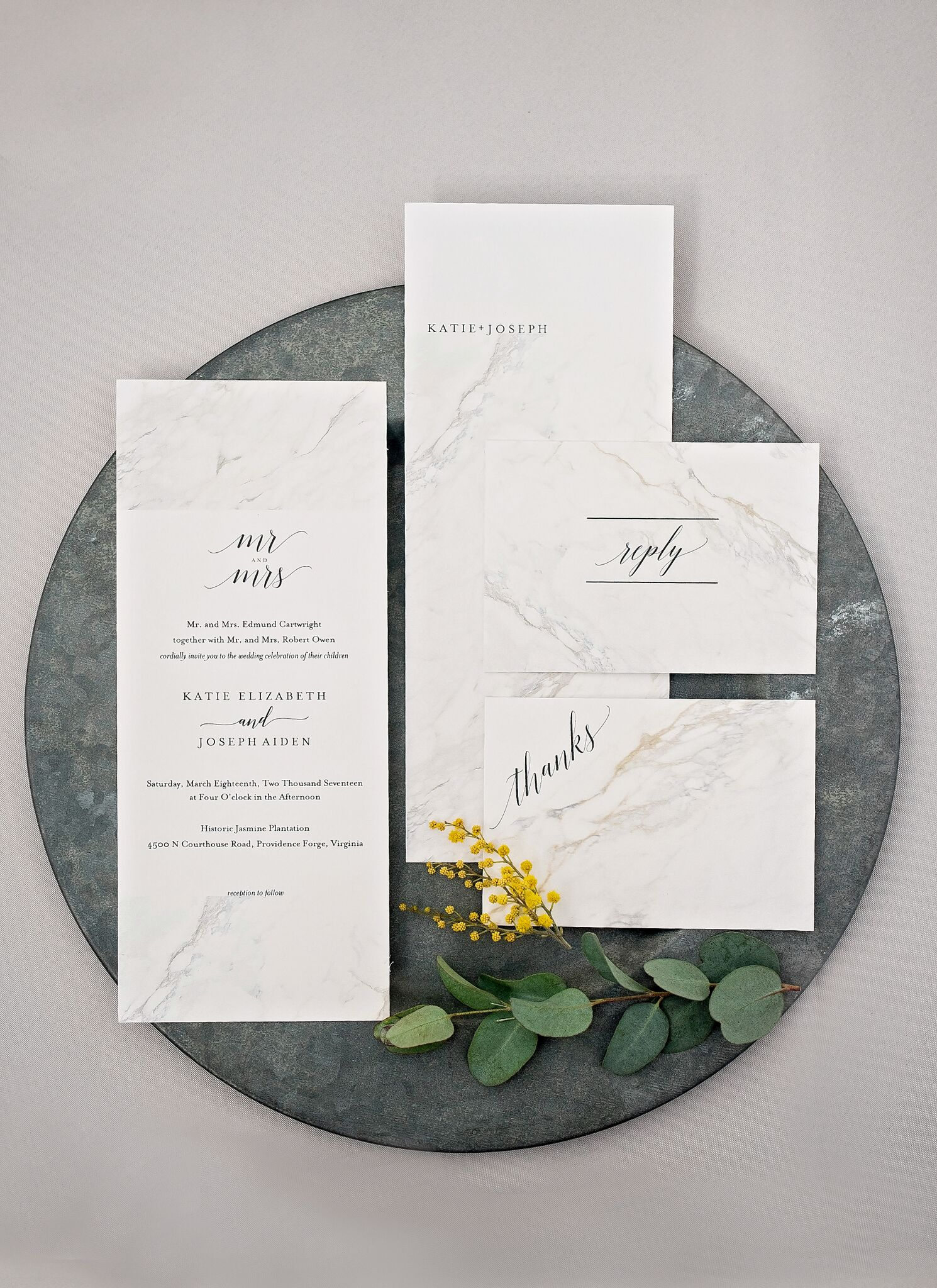 white marble print stationary with black calligraphy