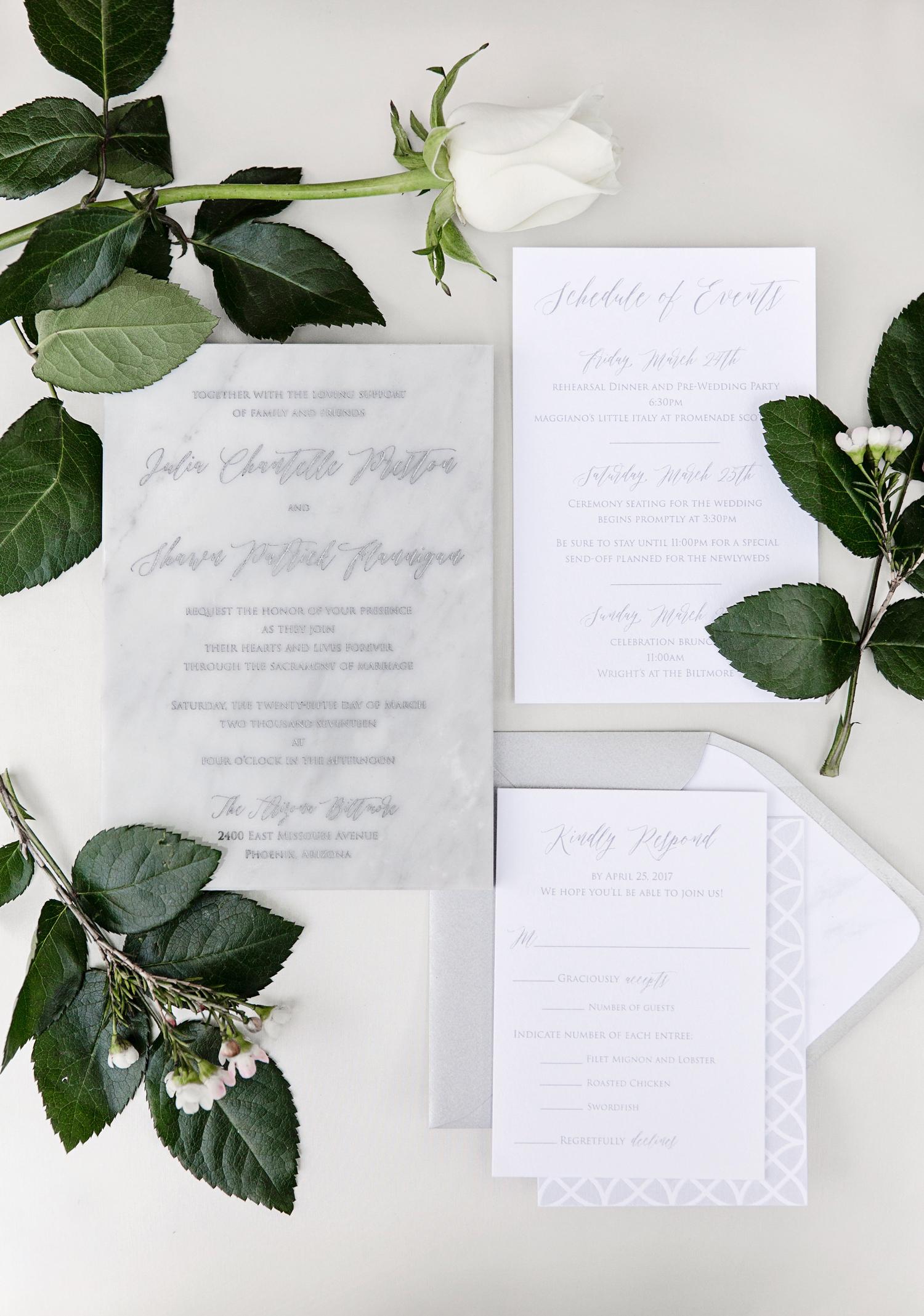 muted white marble design stationary wedding invites