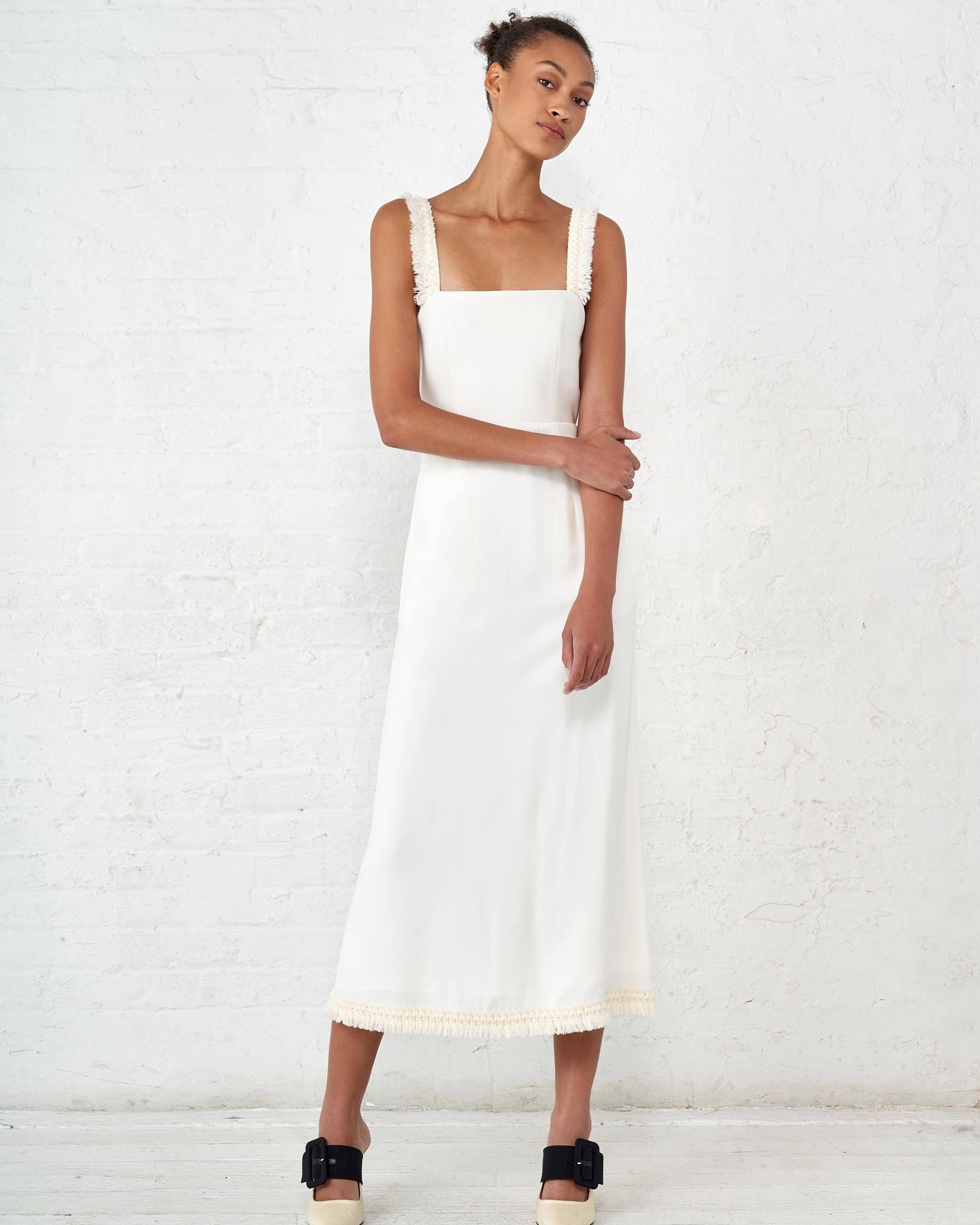 white sleeveless square neckline dress