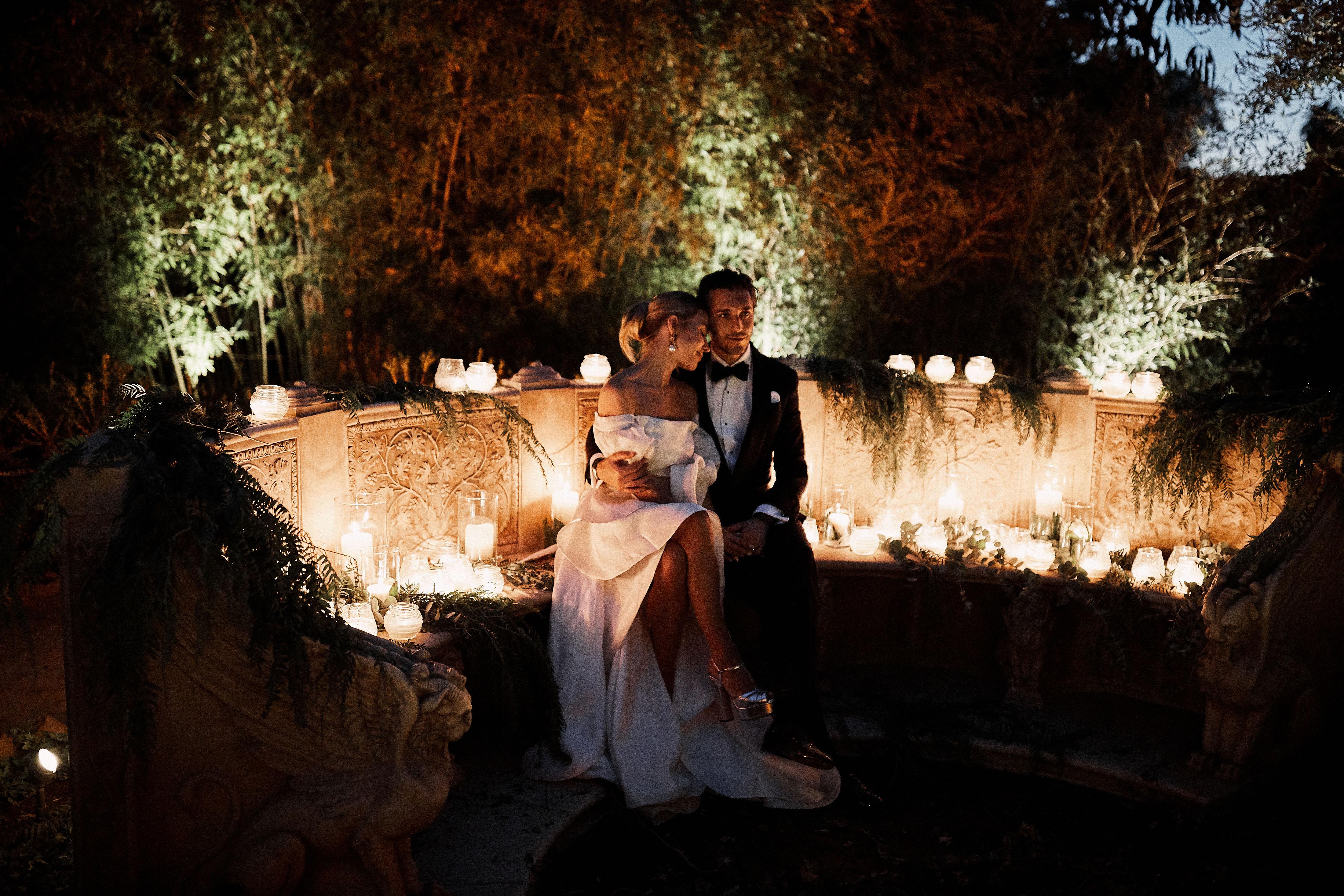 karolina sorab wedding couple hugging surrounded by candles