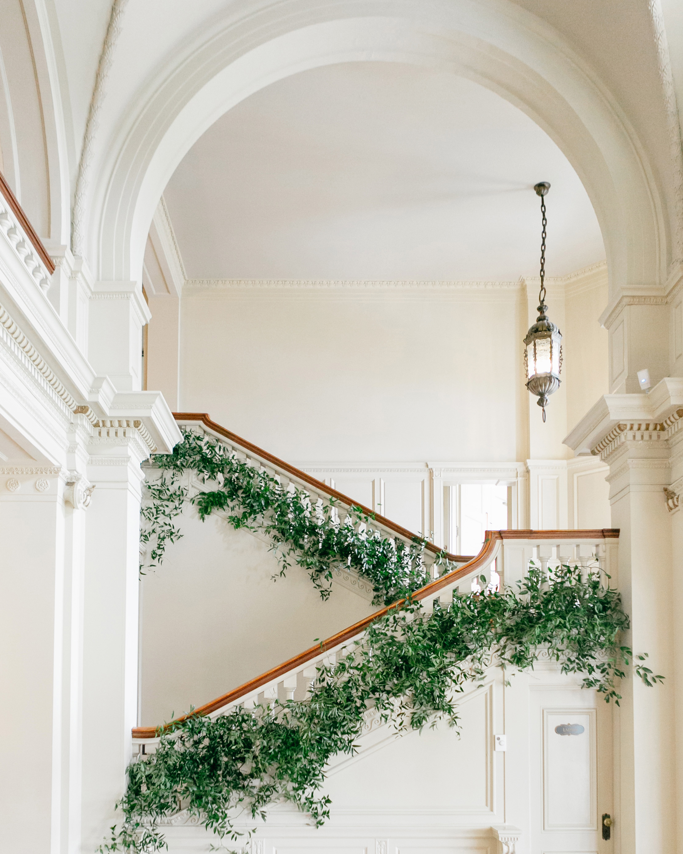 staircase switchback banister decor bright greenery