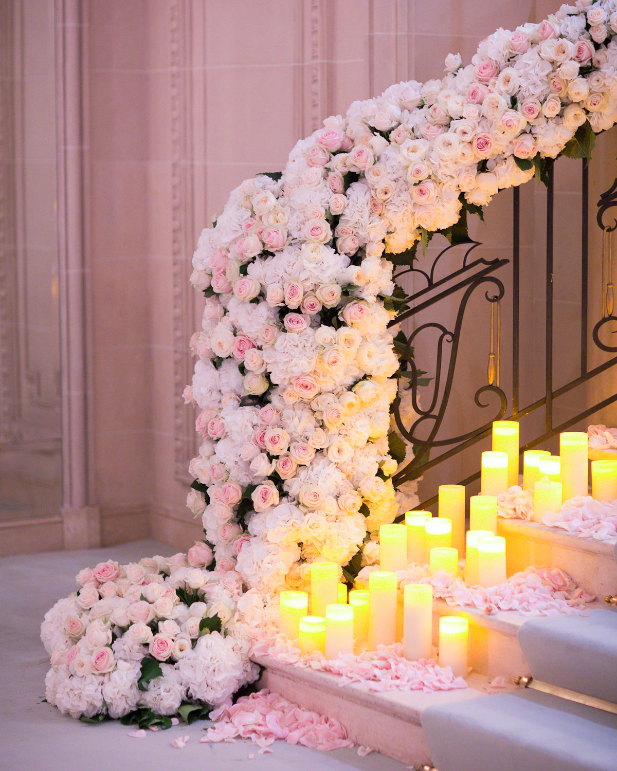 stair banister decor candle light pink roses and white hydrangea