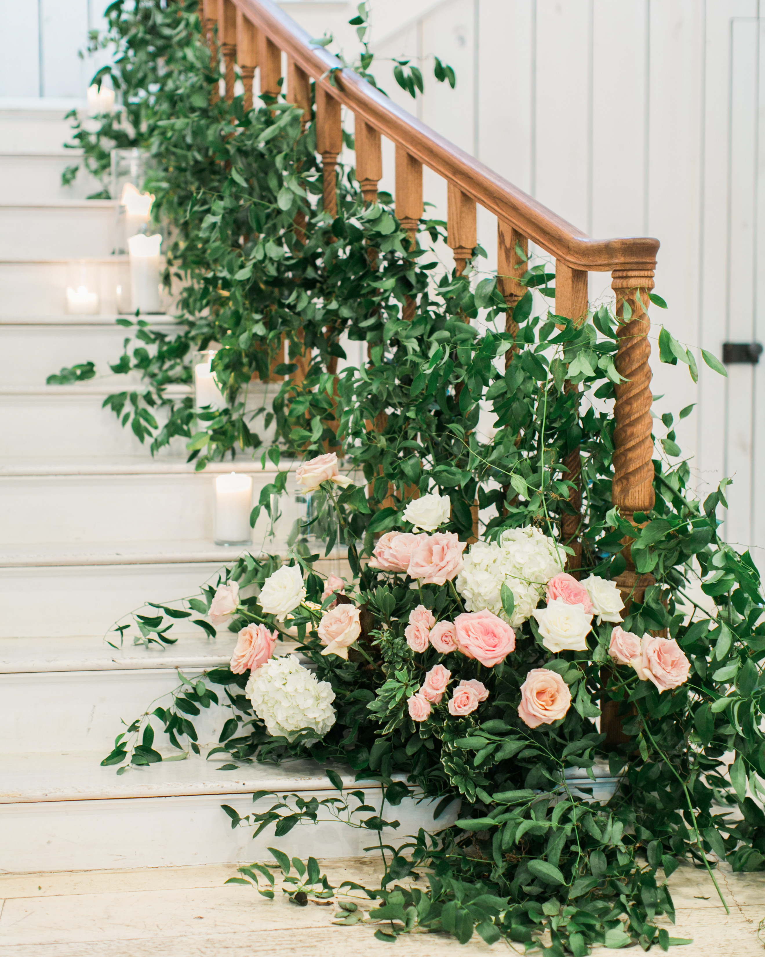 stair banister decor weaved roses and greenery